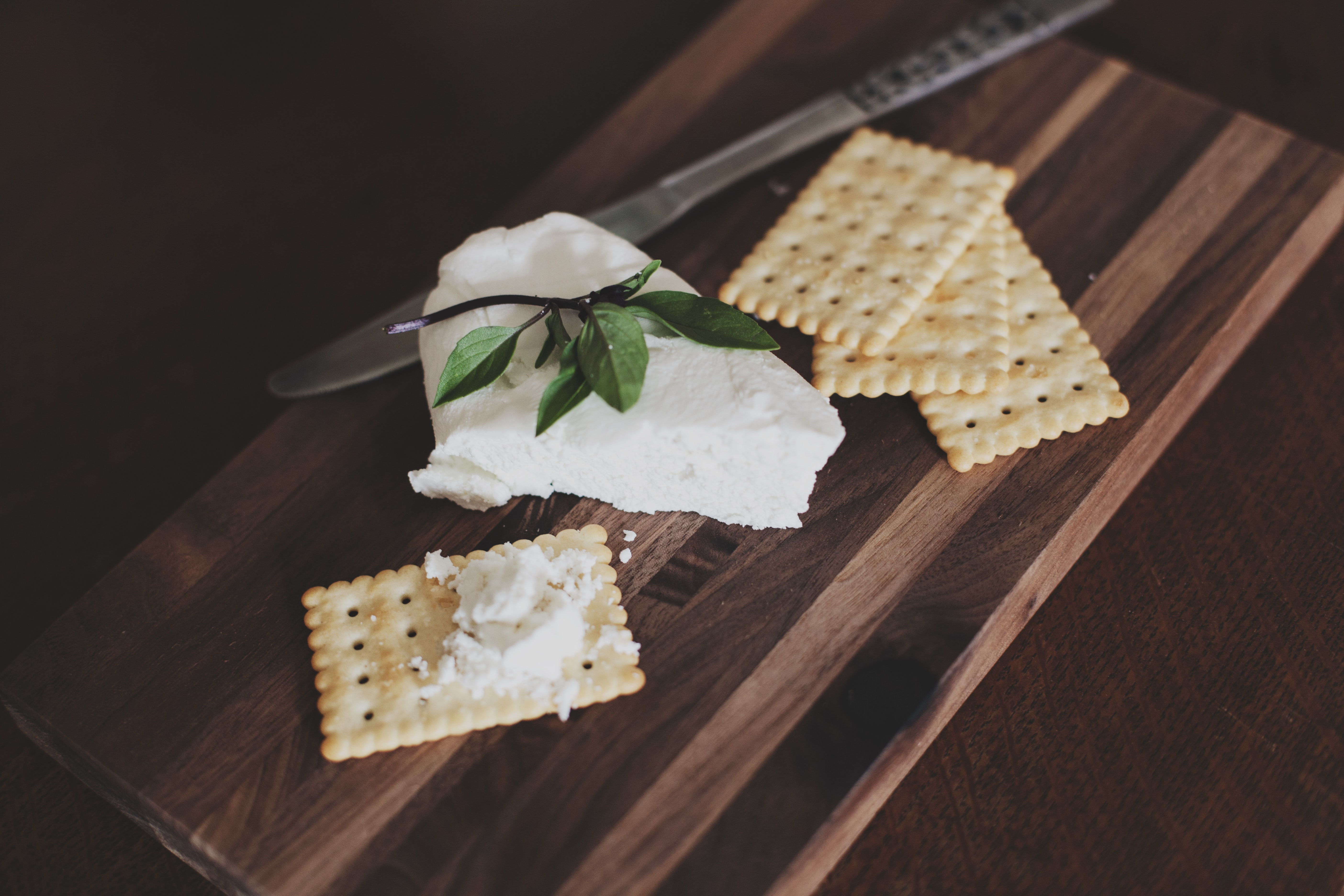 A slice of brie cheese and crackers.