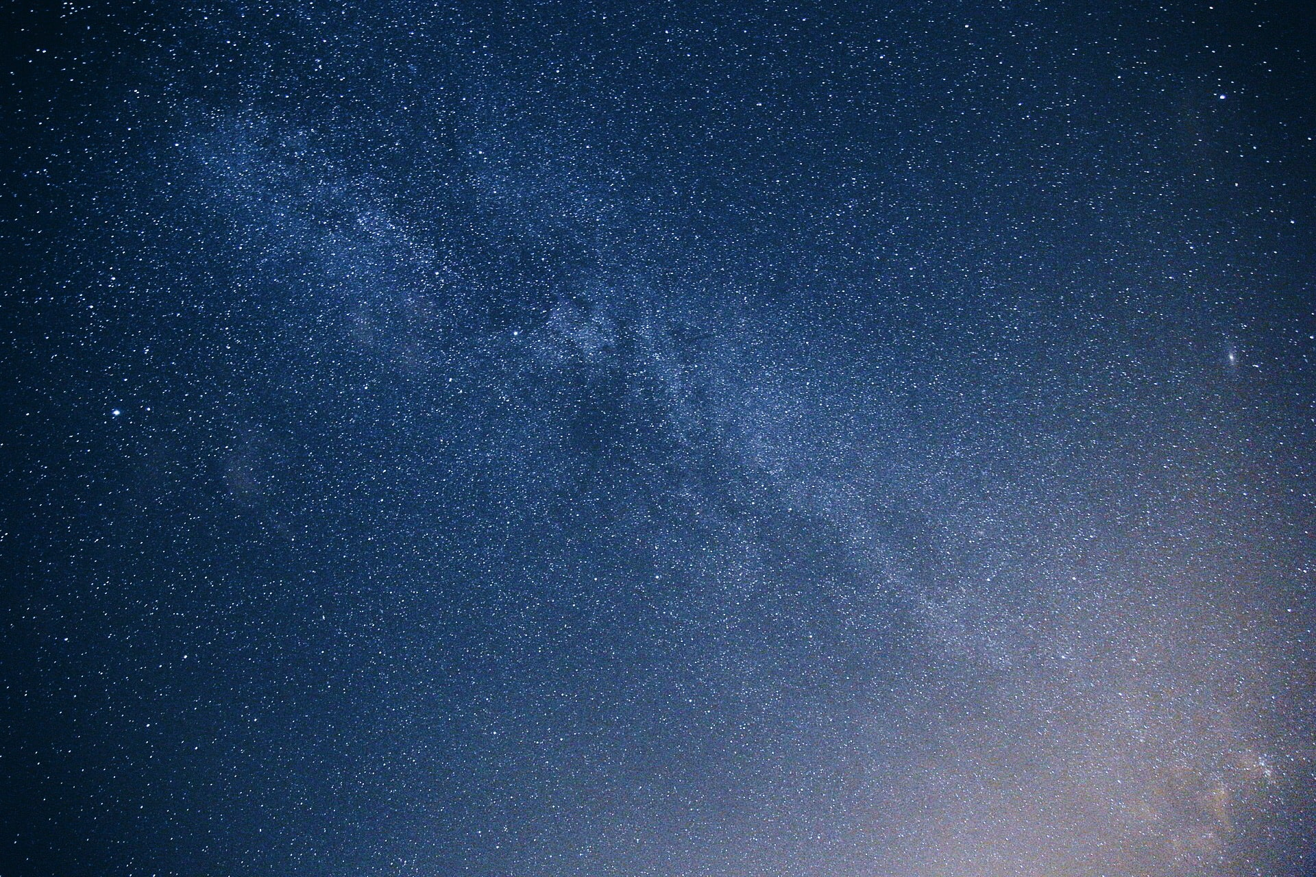 A closeup view of the Milky Way in the dark blue night sky.