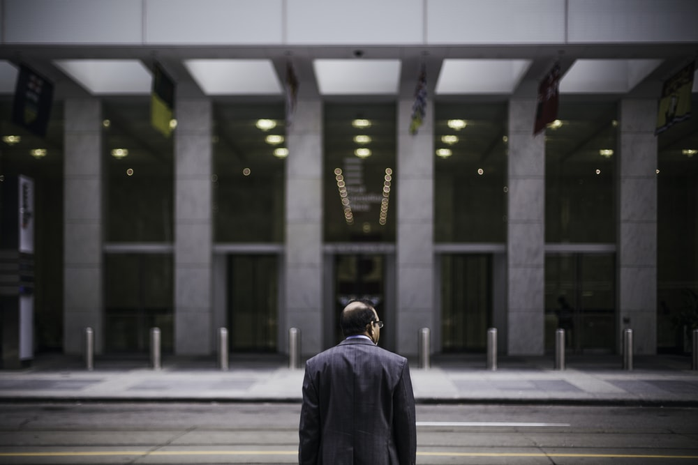 man standing in front of building