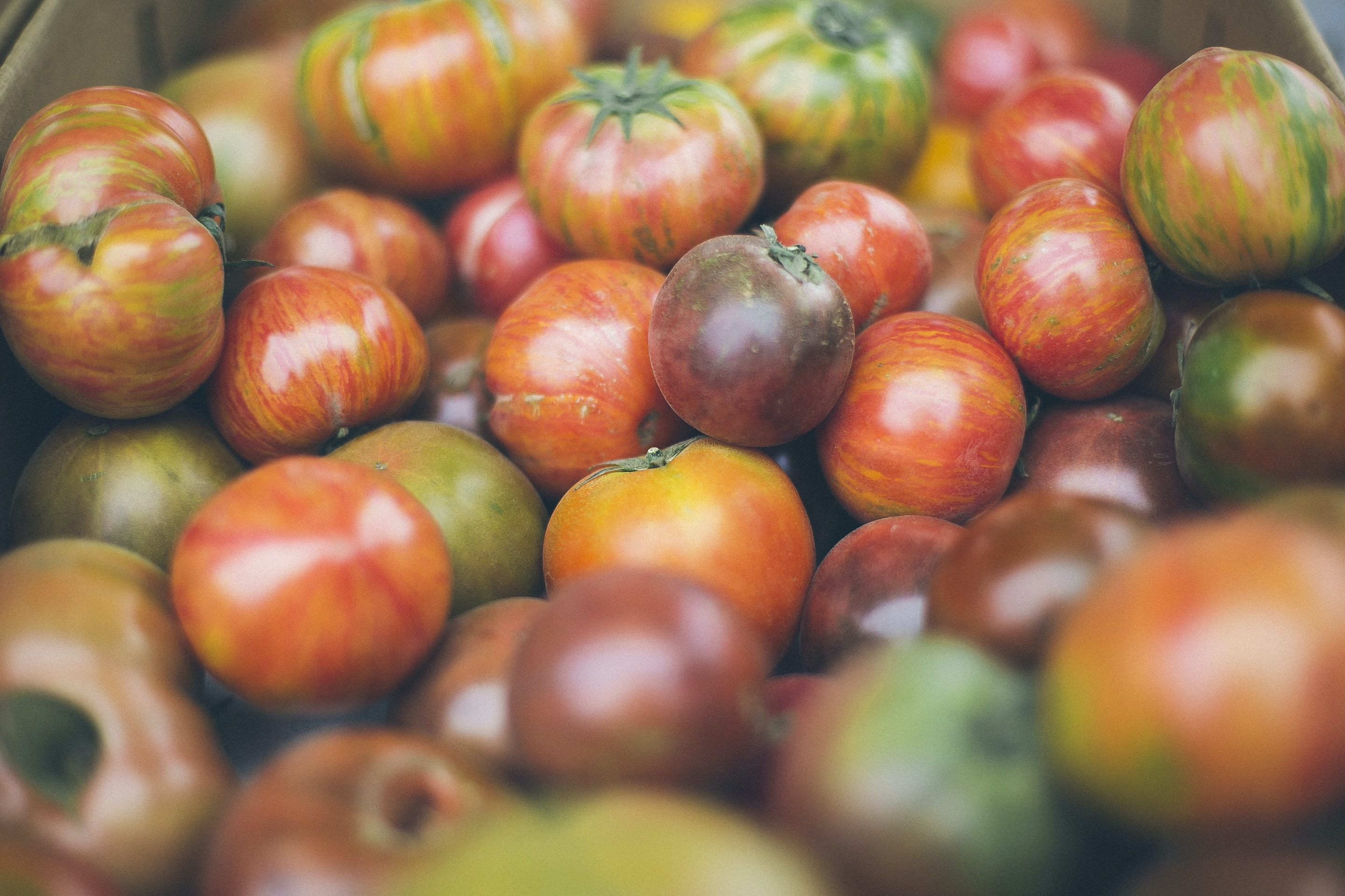 Box of heirloom tomatoes at a farmer's market