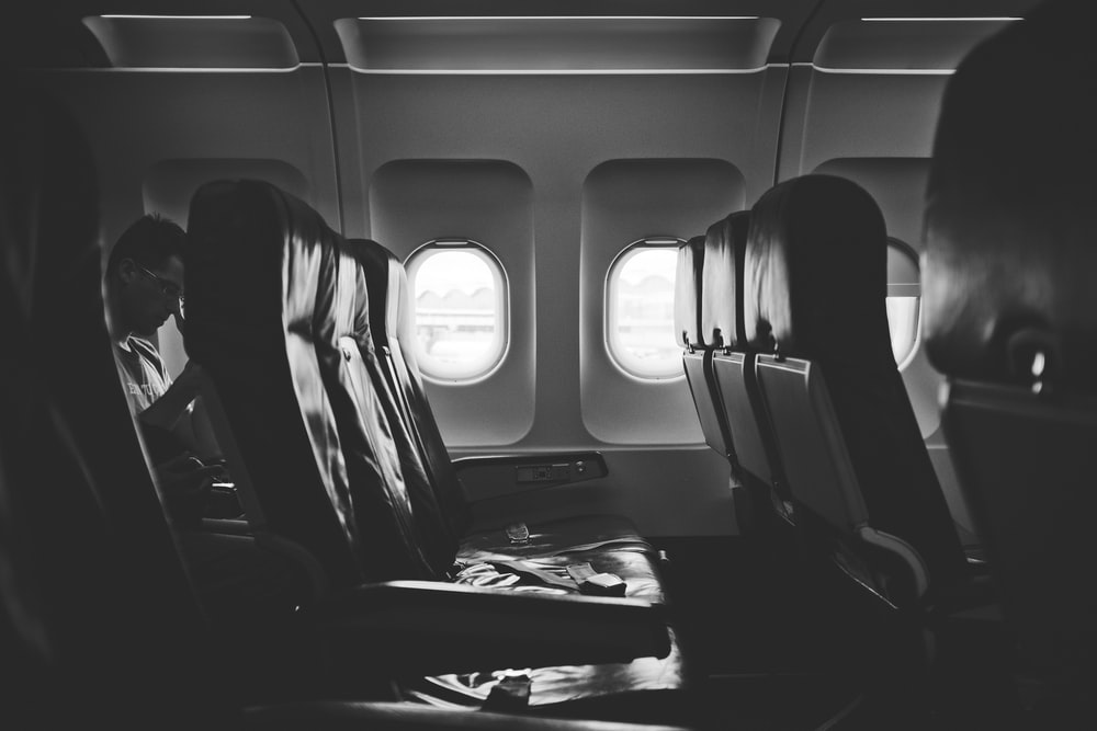grayscale photo of airplane seats