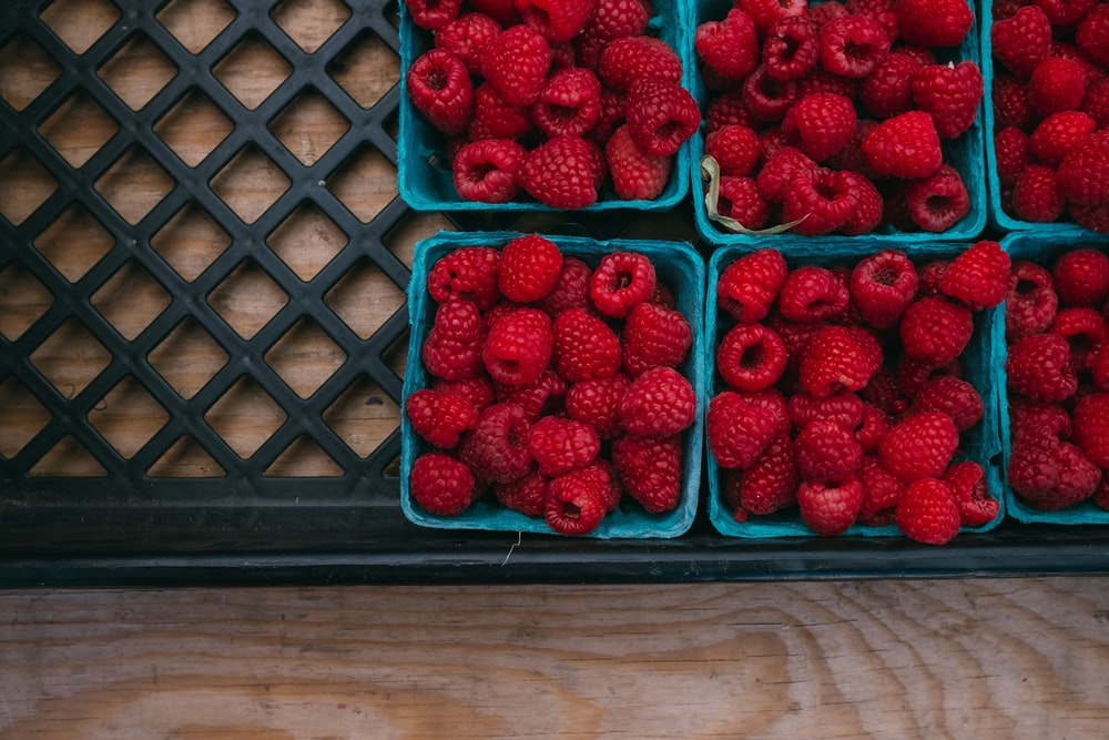 bunch of strawberries in containers
