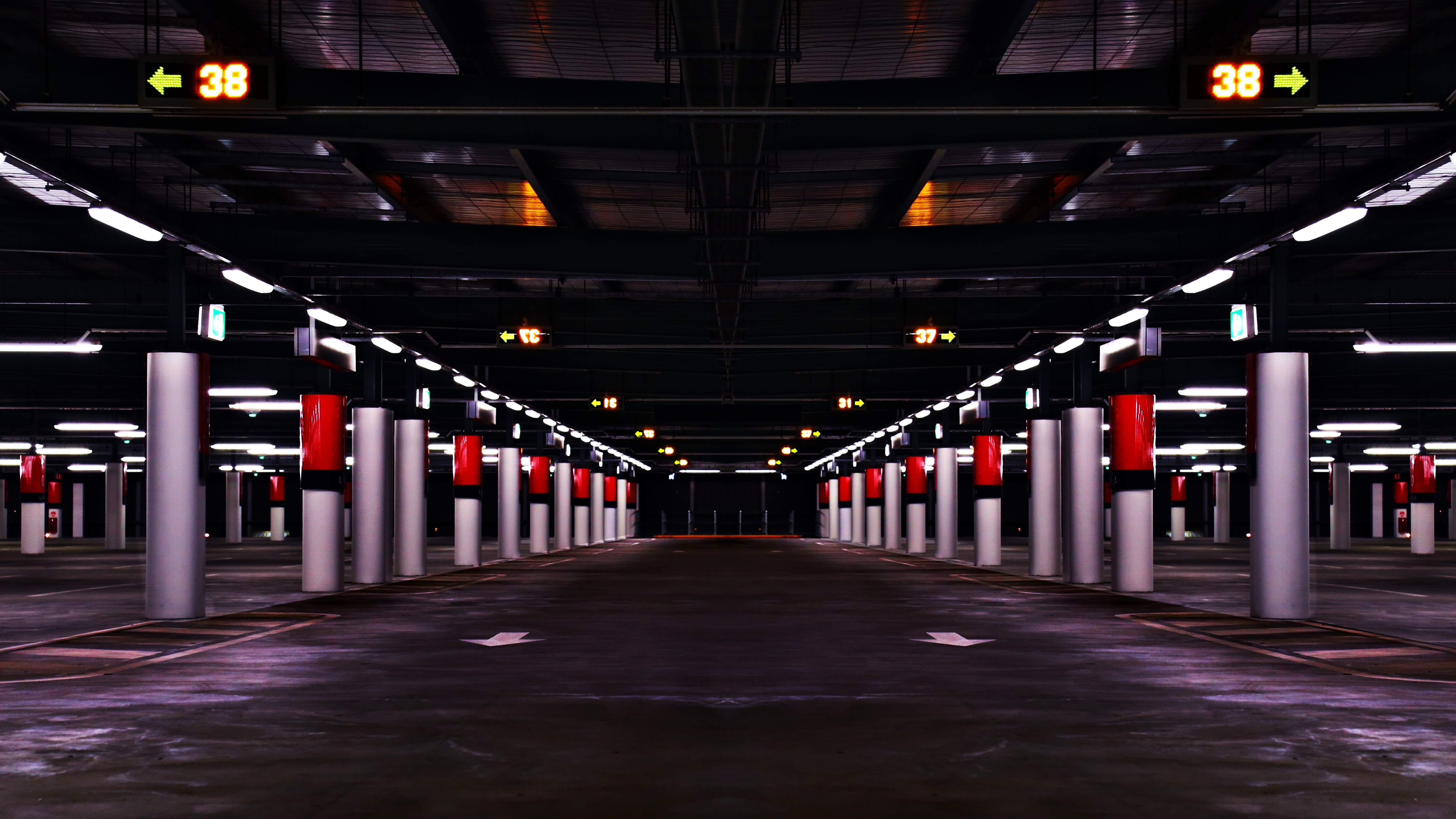 Columns form patterns and lines in an underground parking structure