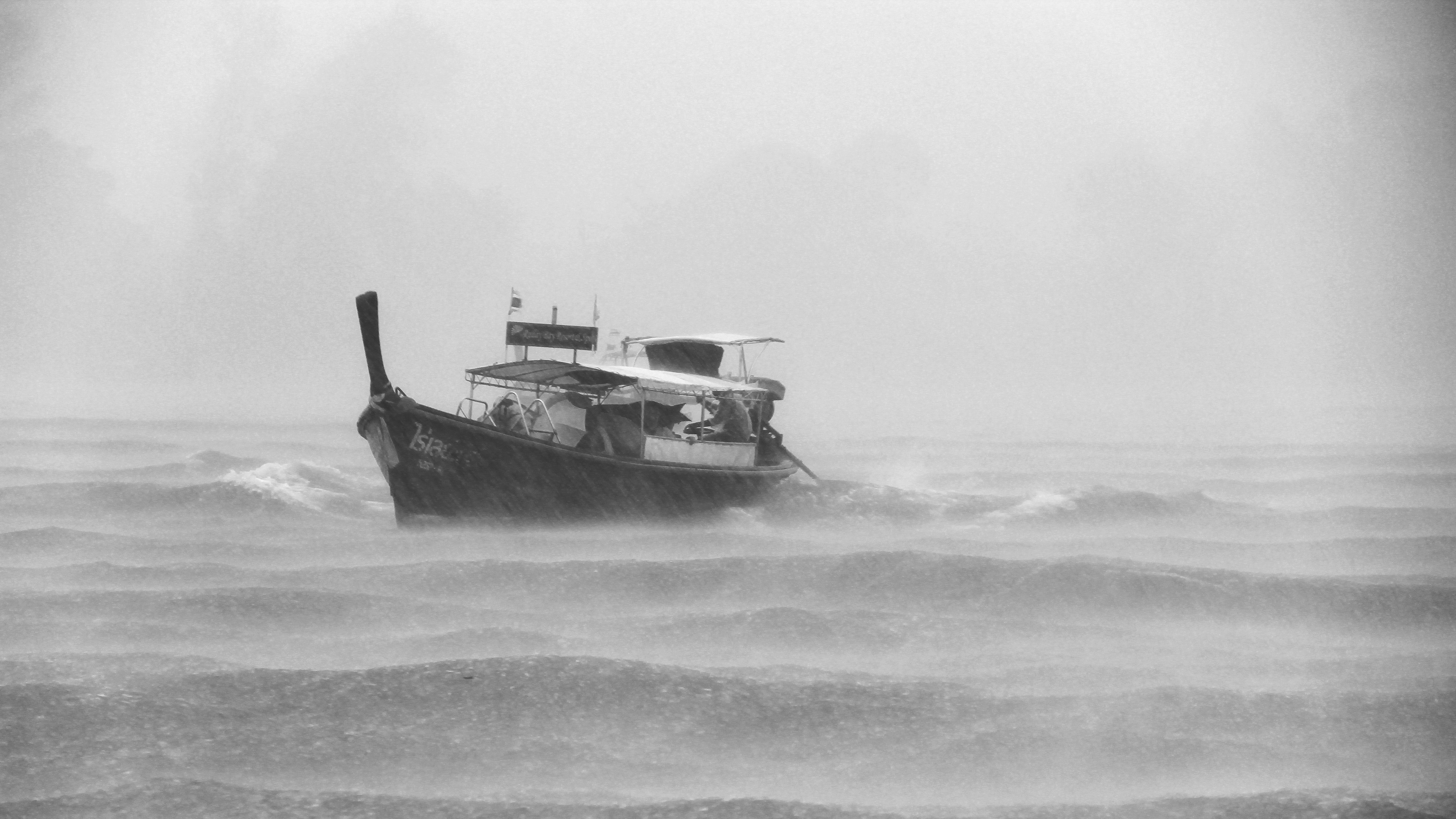 grayscaled photo of boat