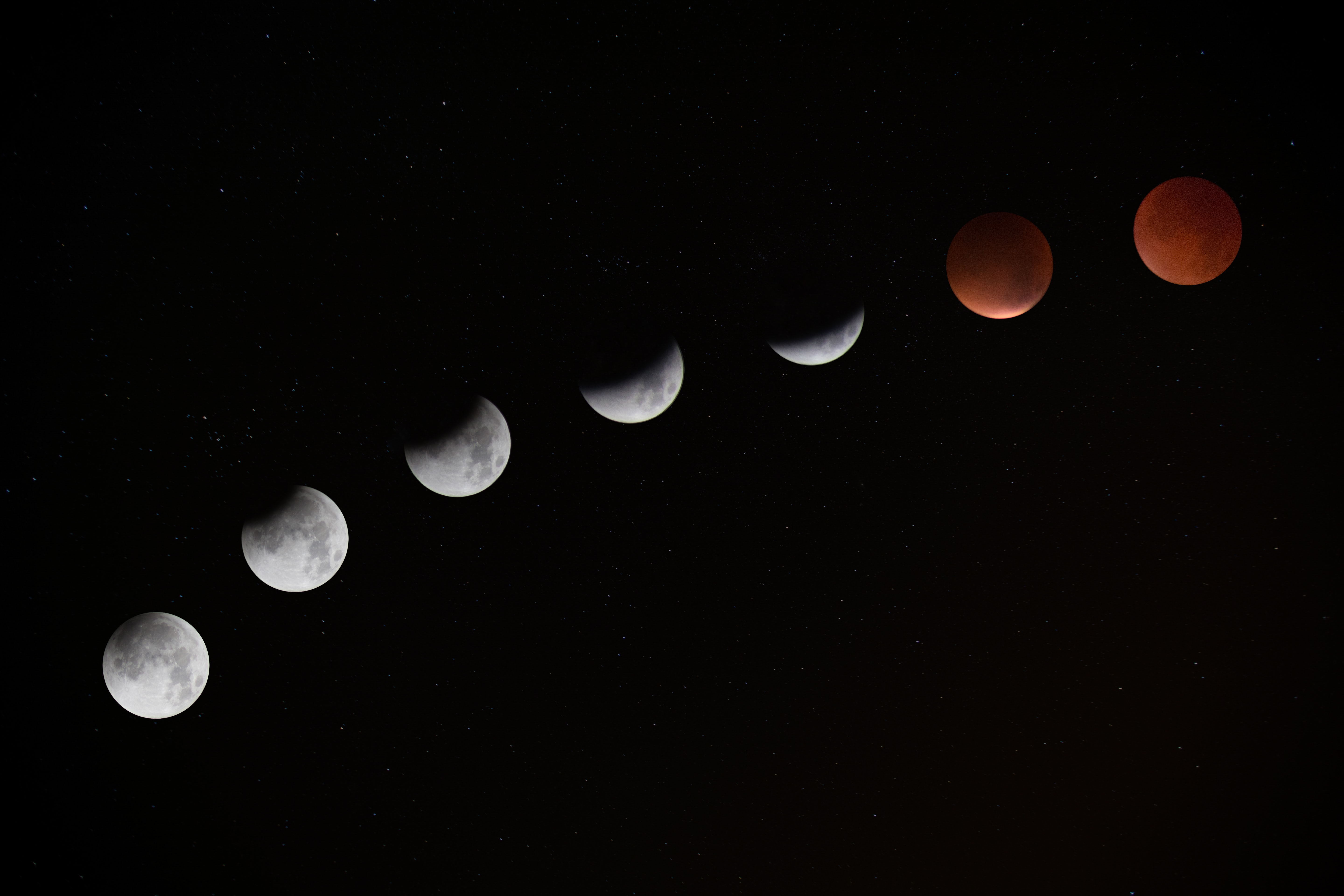 Long-exposure photograph showing the Moon turning red during a lunar eclipse at Telscombe Cliffs