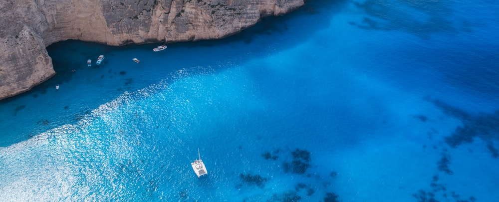 boat on body of water in aerial photography