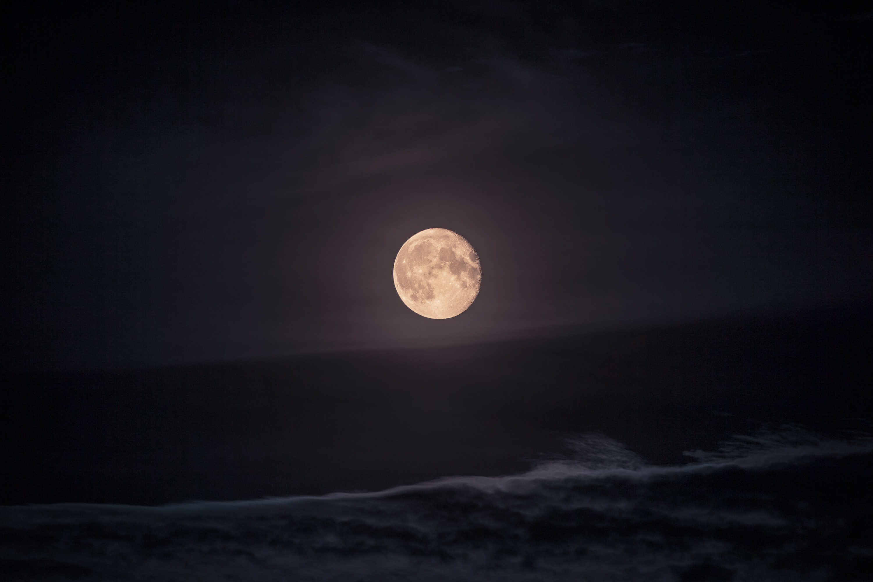 photography of moon at night time
