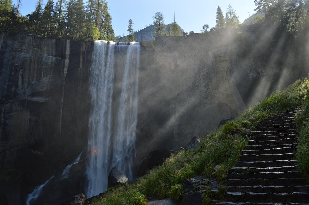 man-made stairs near waterfalls