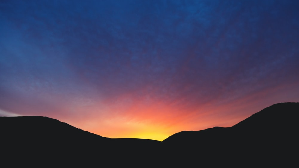 silhouette photography of hills