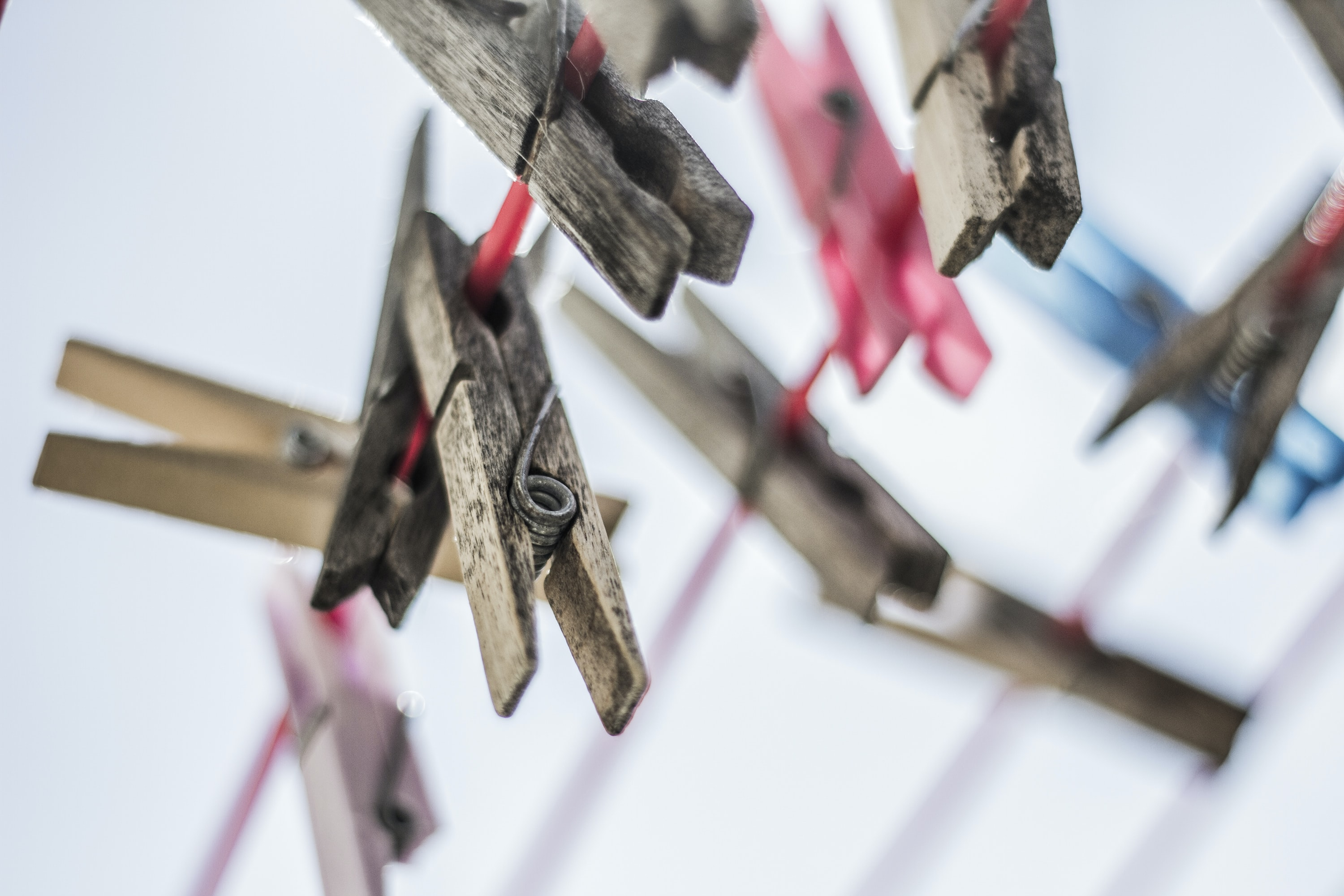 Rustic clothespins hung on a laundry line