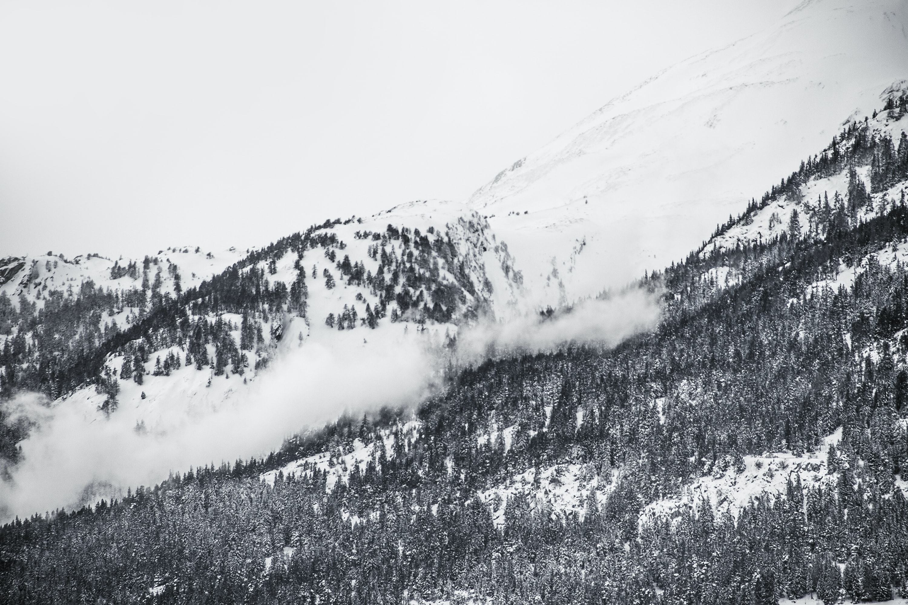 Black and white view of mountain ridges in Ried-Brig
