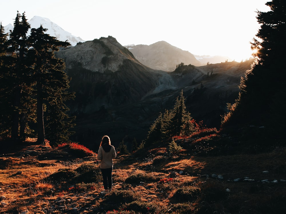 woman standing in front of mountains