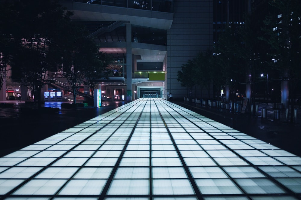 lighted road during nighttime