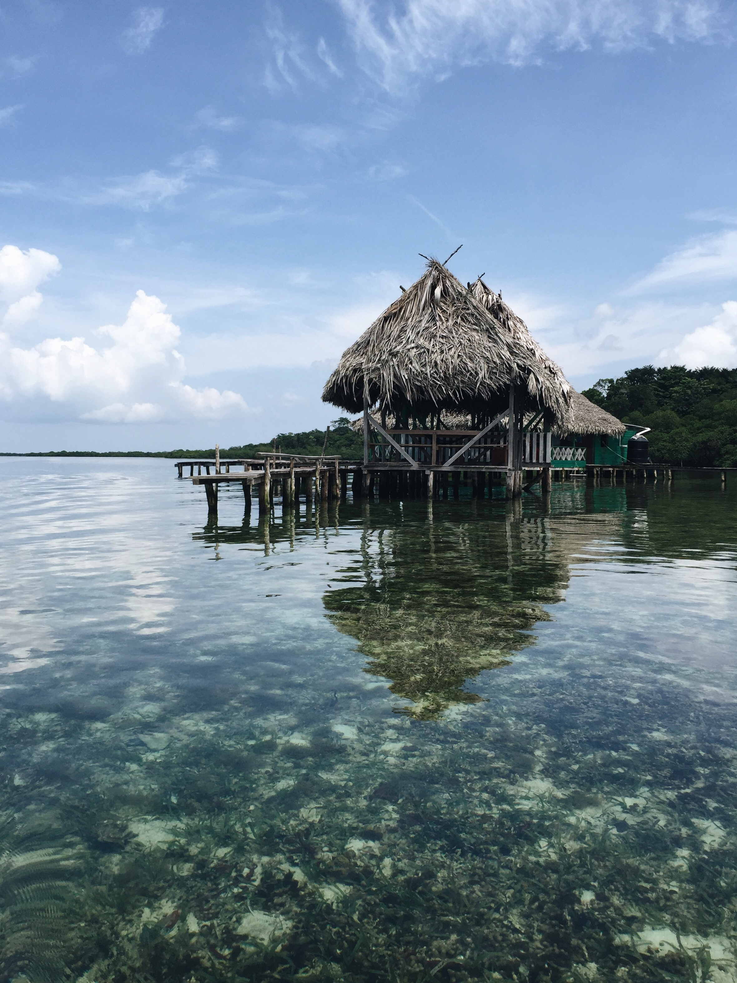 A boathouse by the clear ocean water