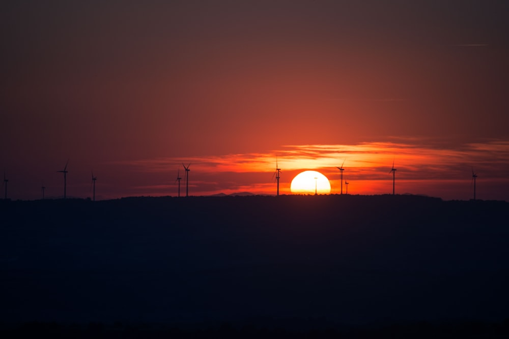 silhouette of electric windmills
