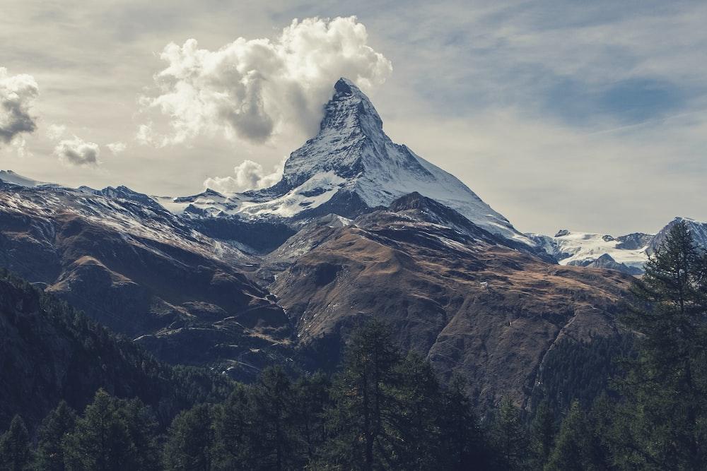Matterhorn under clouds photo by sven scheuermeier sveninho on snowy mountains and cloud stopboris Images