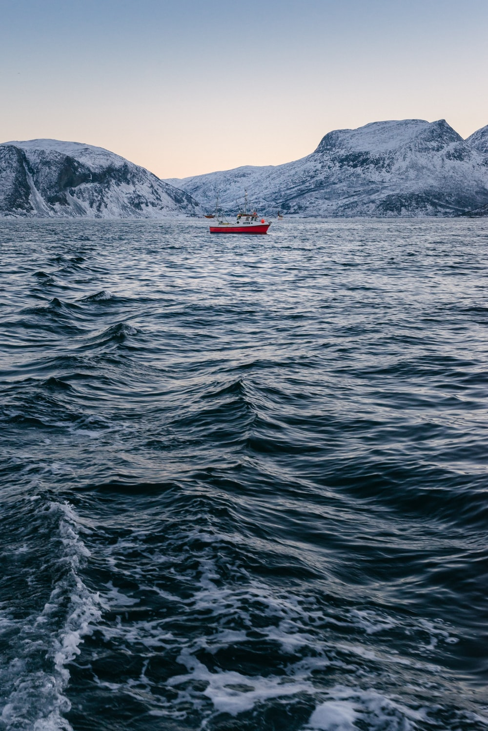 red boat in on body of water