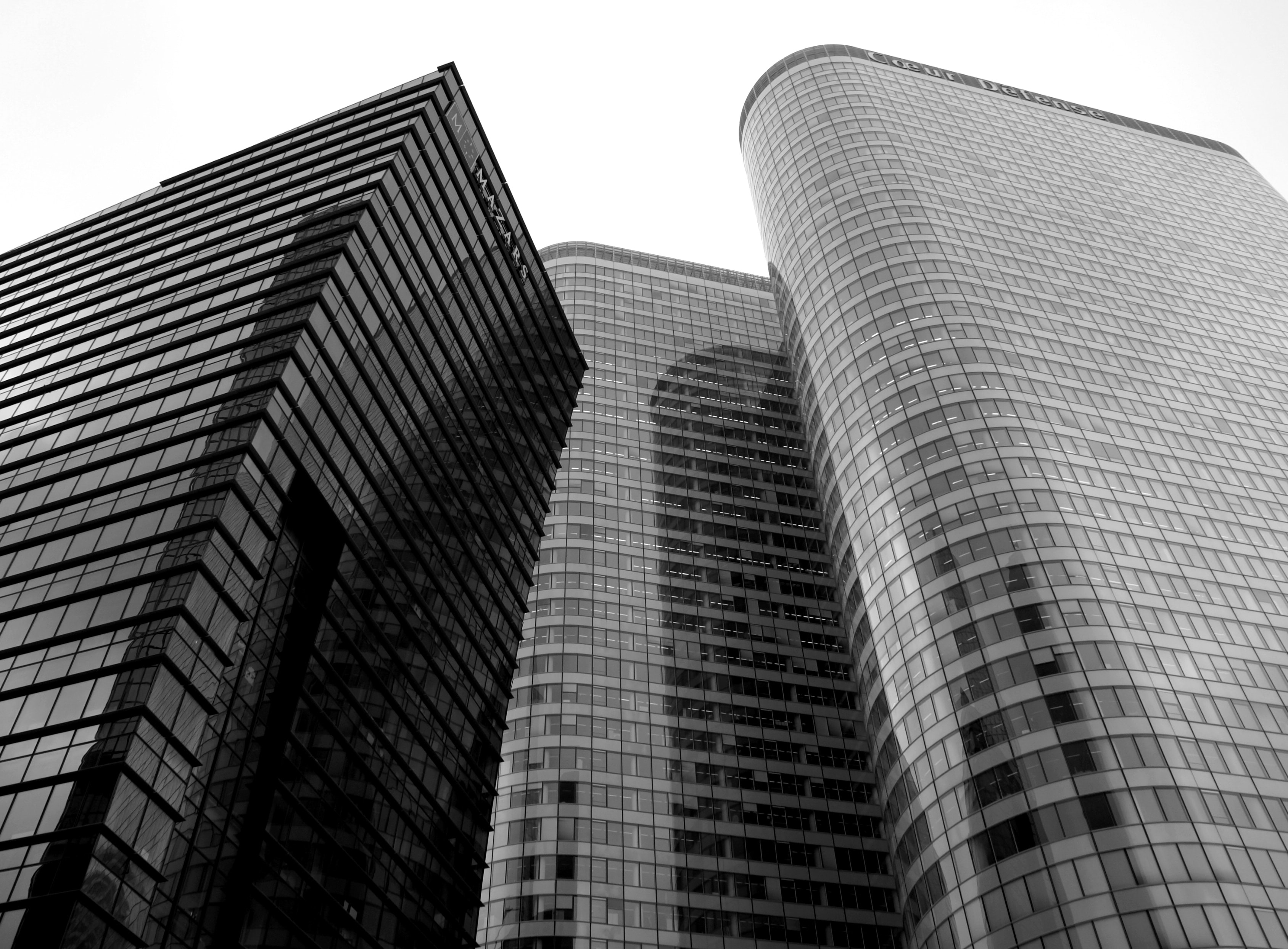 A desaturated shot of tall office buildings
