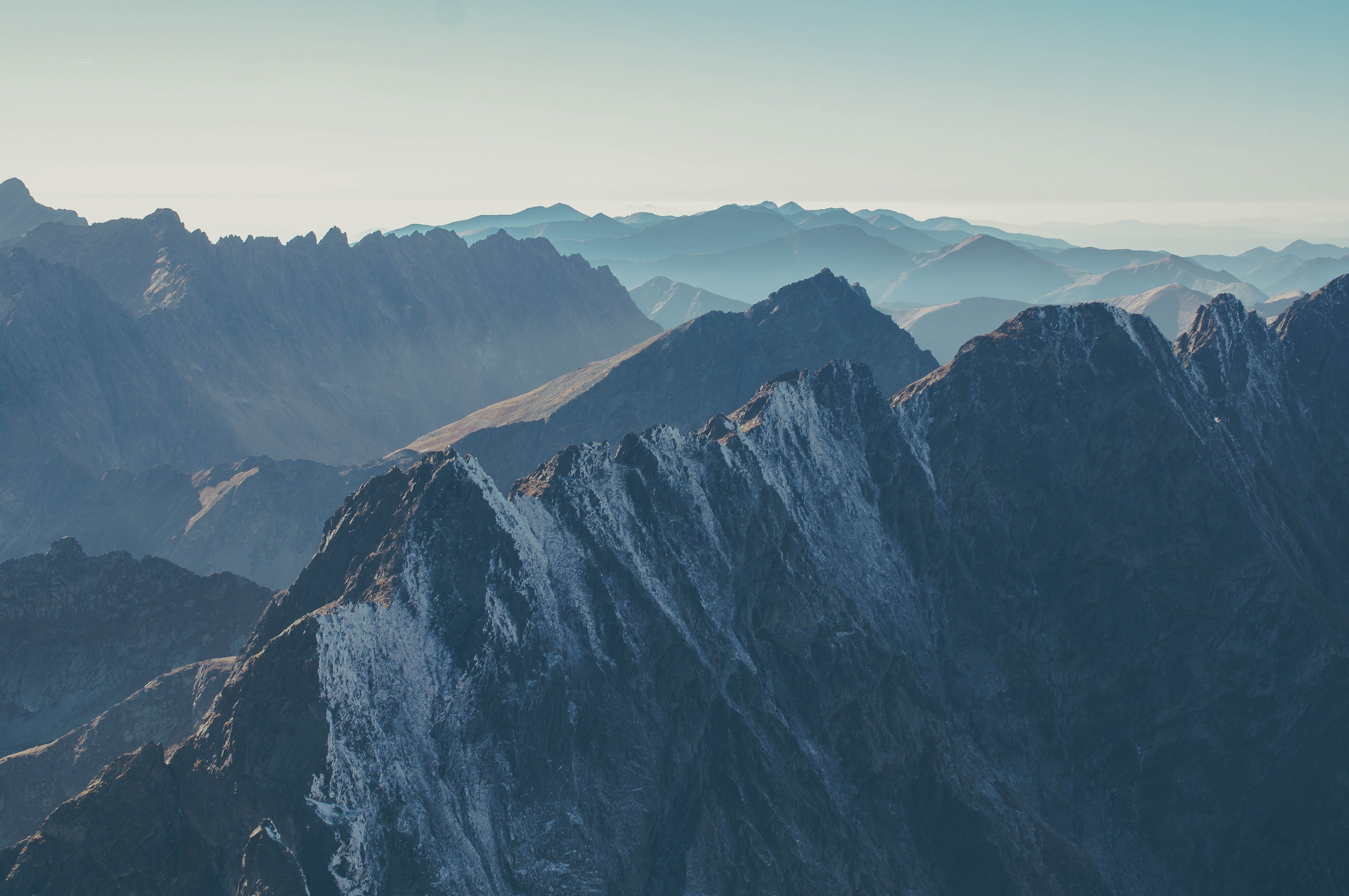 Sharp mountain ridges stretching to the horizon in the High Tatras