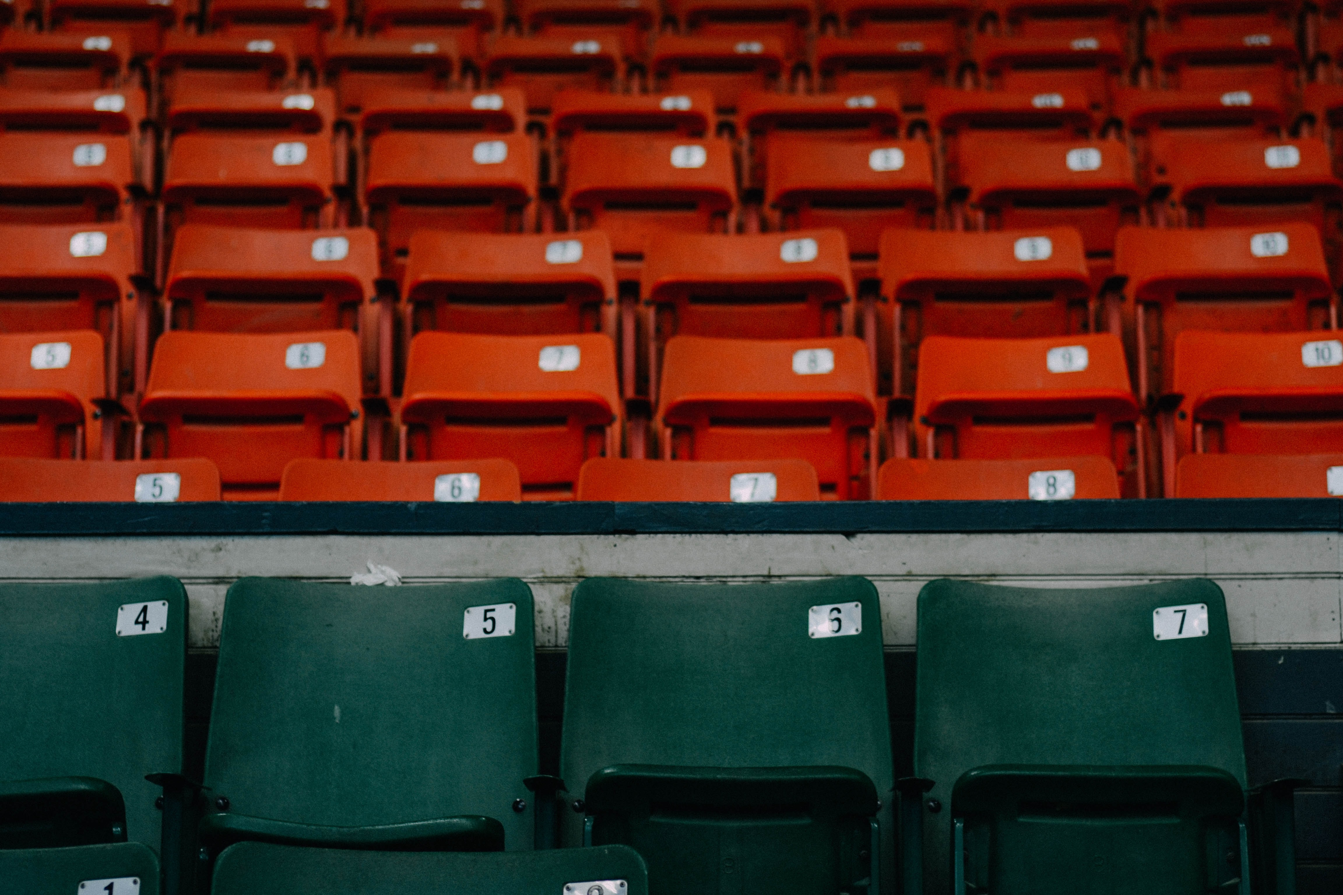 Several rows of numbered seats and a first row of green numbered seats on a Springfield baseball stadium bleacher