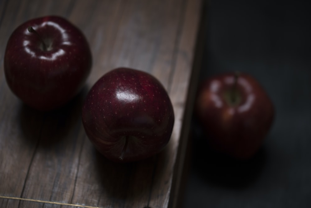 three red delicious apples