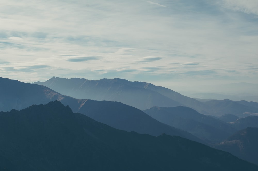 silhouette of mountains covered with fog
