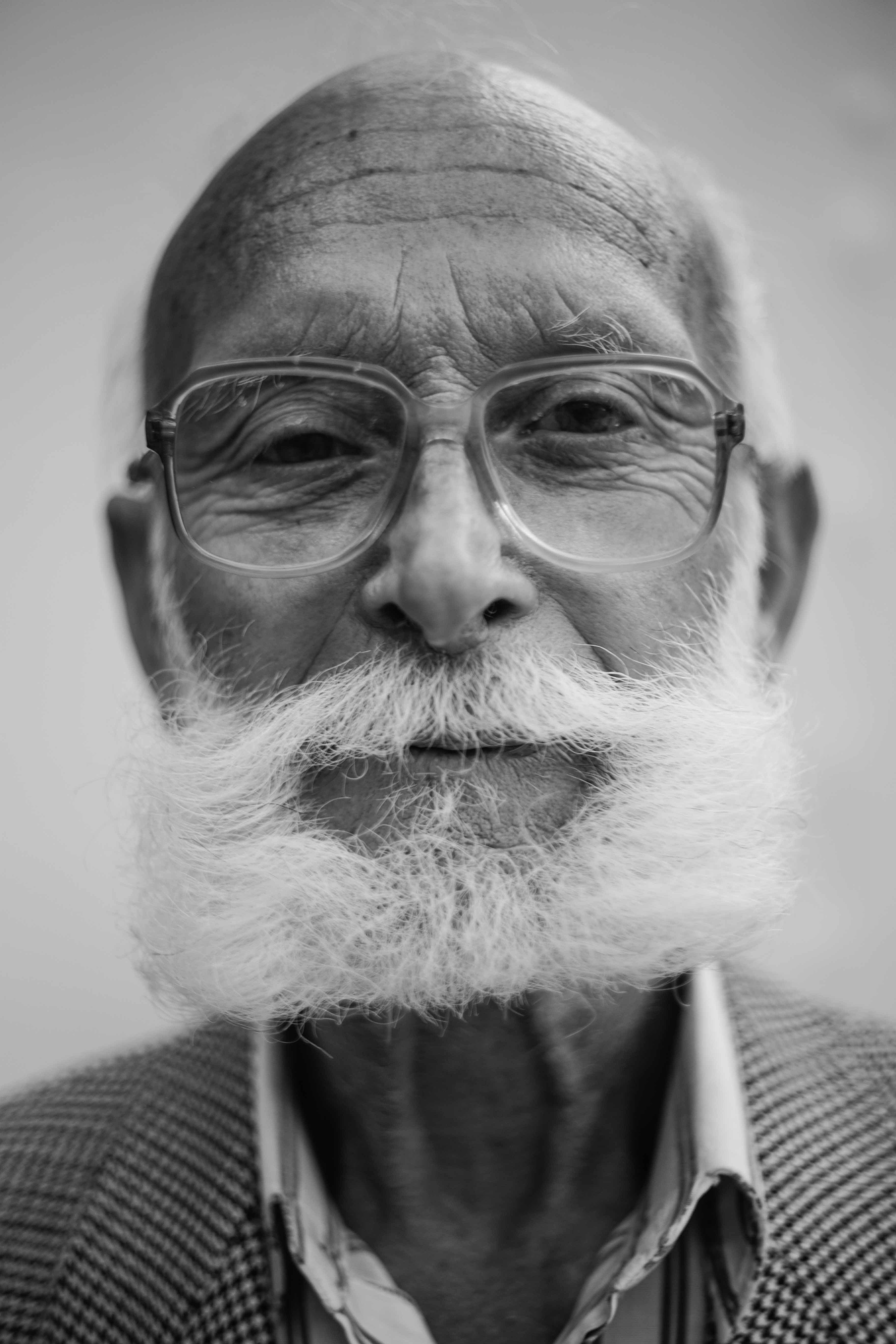 grayscale photo of man wearing eyeglasses
