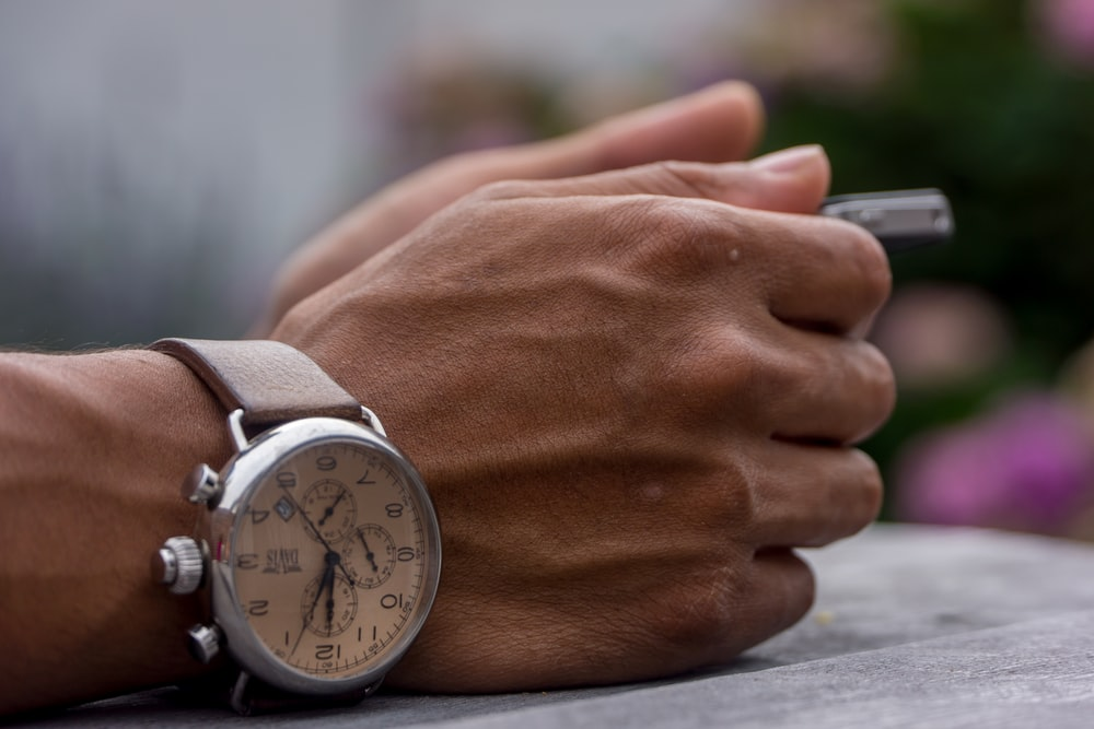 person wearing chronograph watch