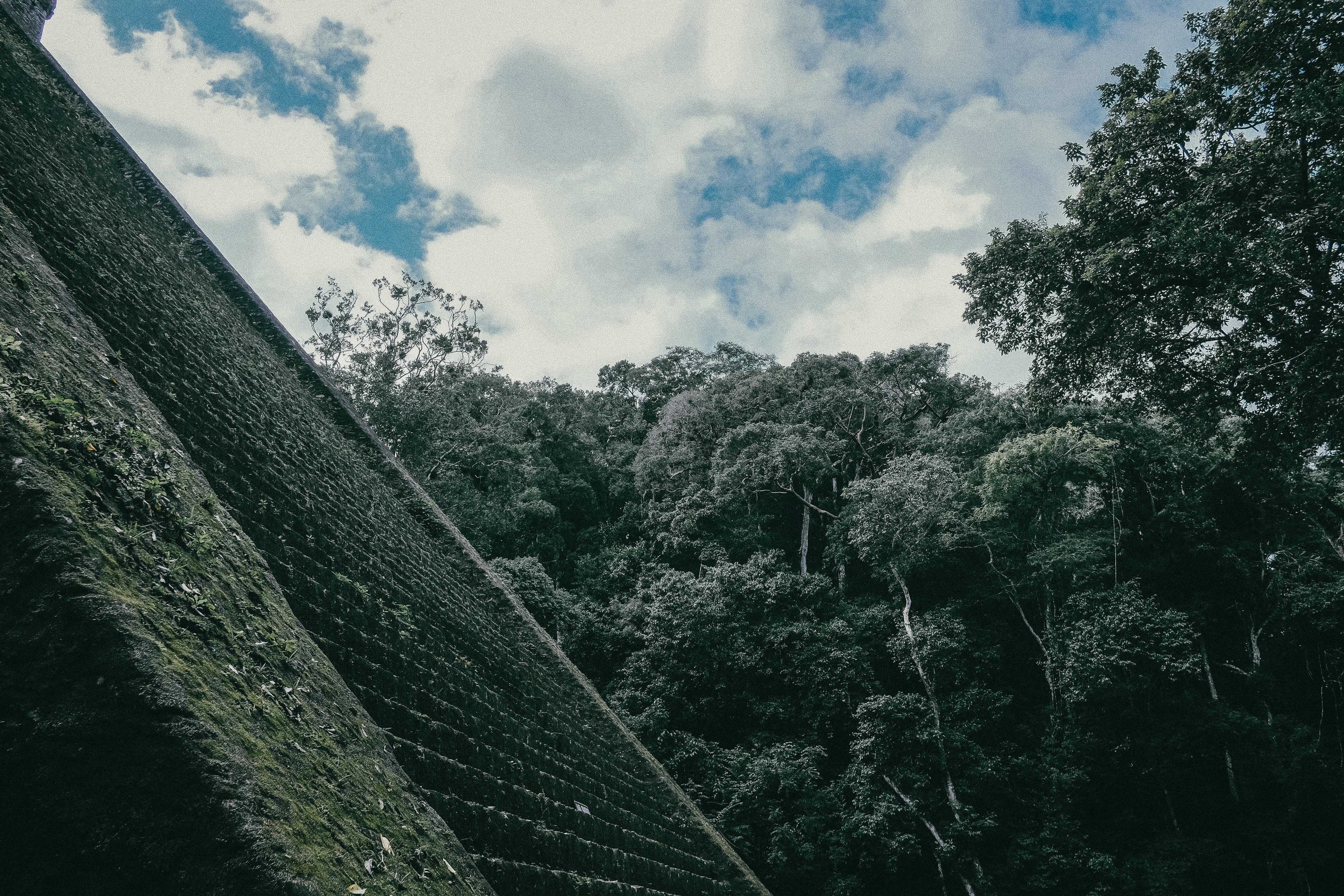 A pale shot of the steep side of the ruins of an Incan temple in Aguas Calientes