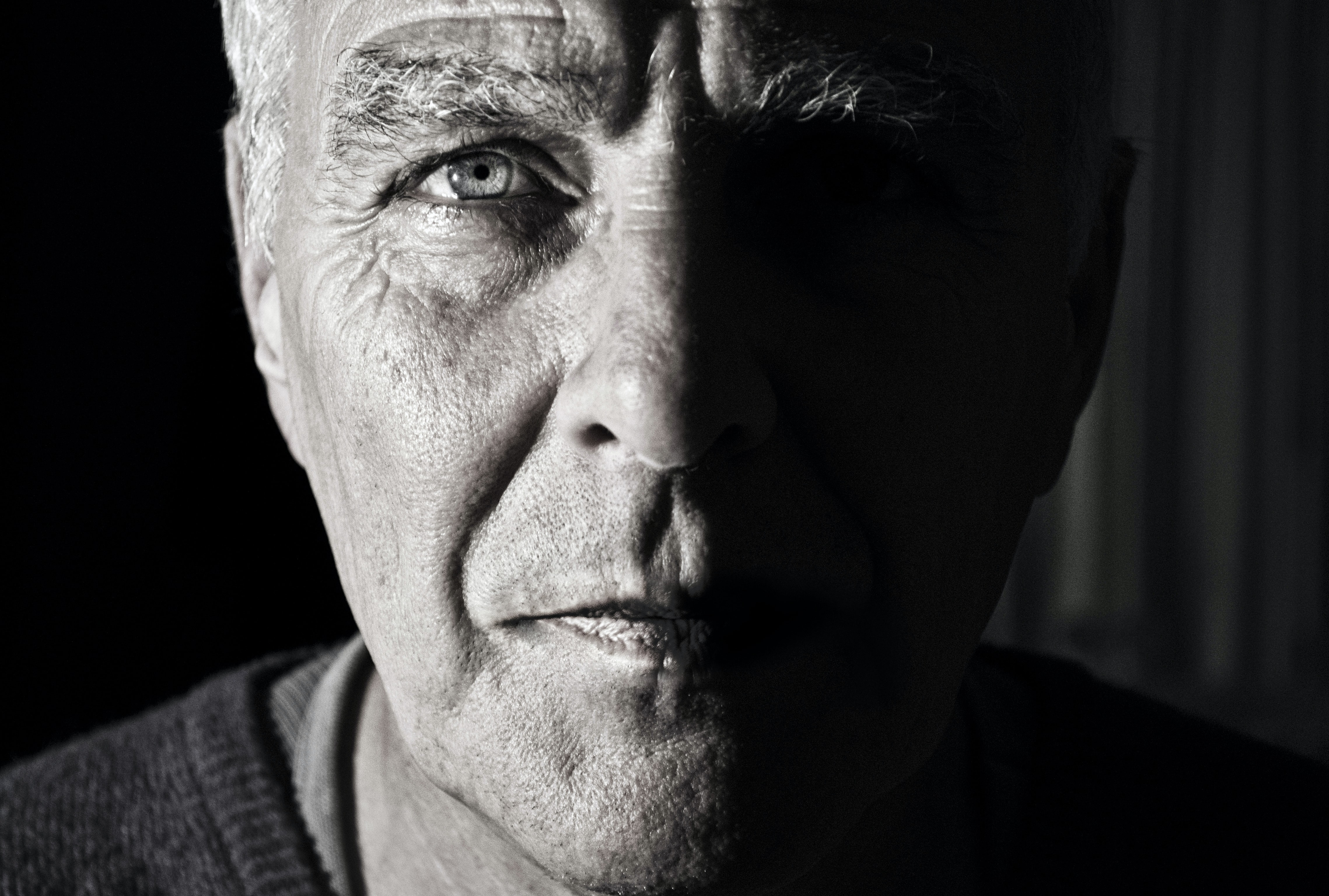 The macro view of the face of an old man with wrinkle face in Venray
