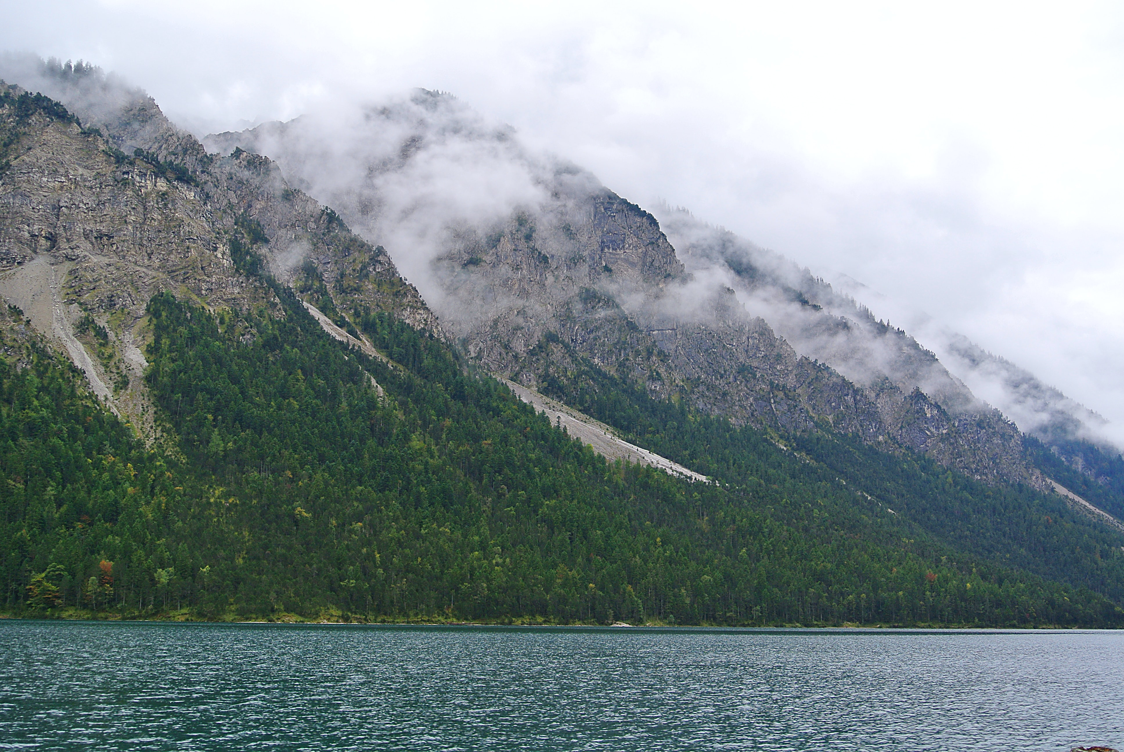 green and gray mountains under white cloudy sky