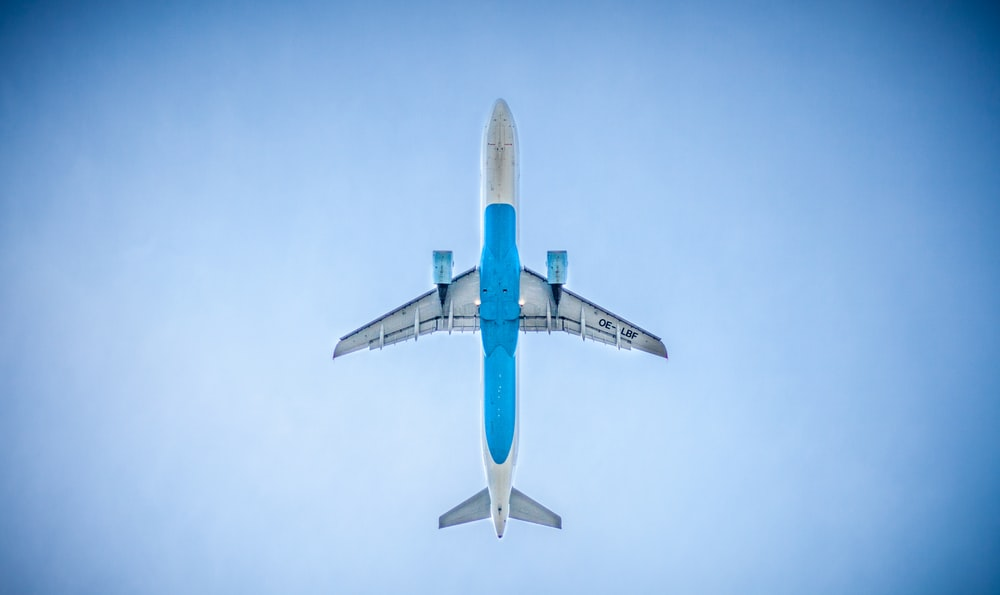 low angle photography of blue commercial airplane