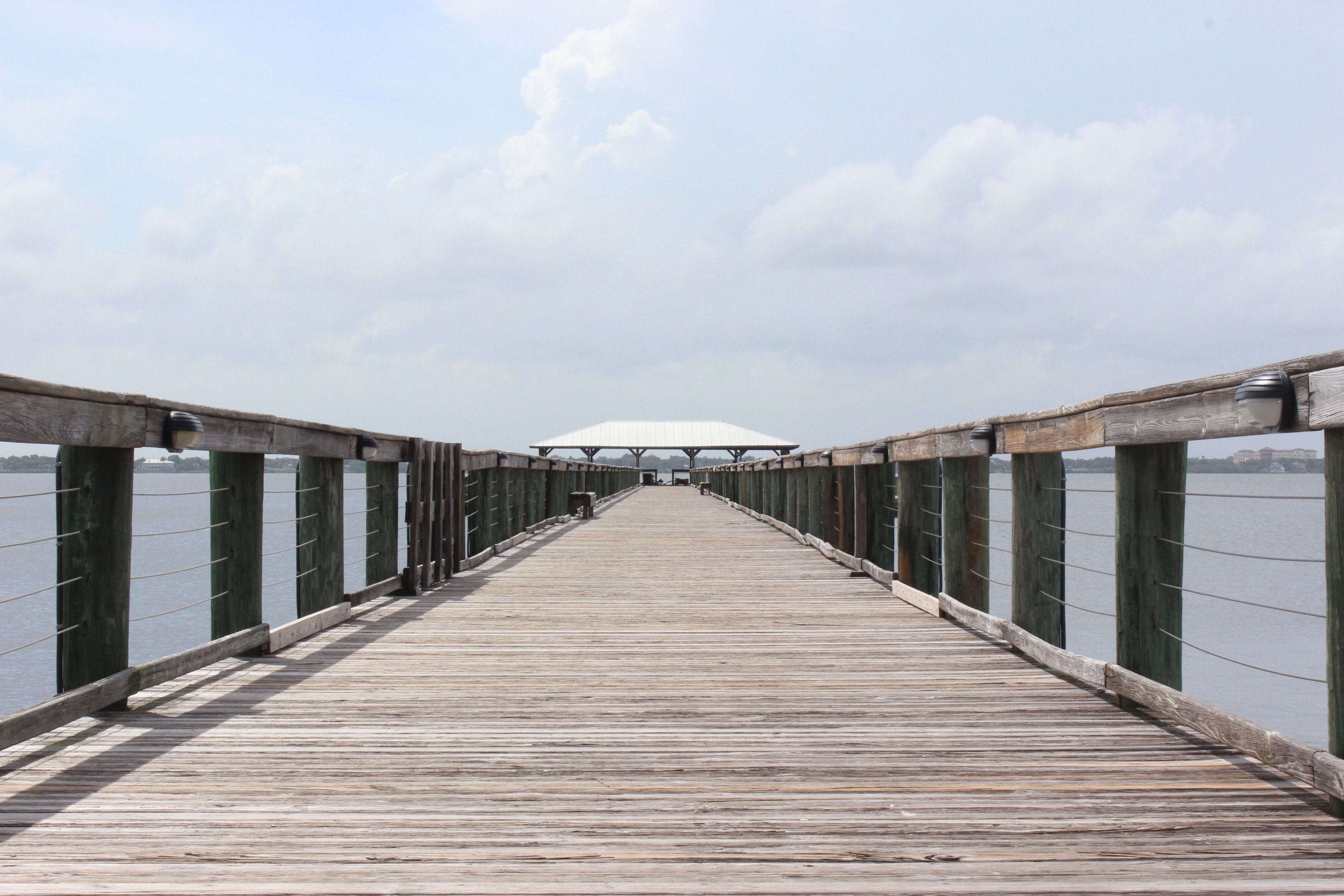View of the wooden pier walkway with a pavilion at the Melbourne Beach