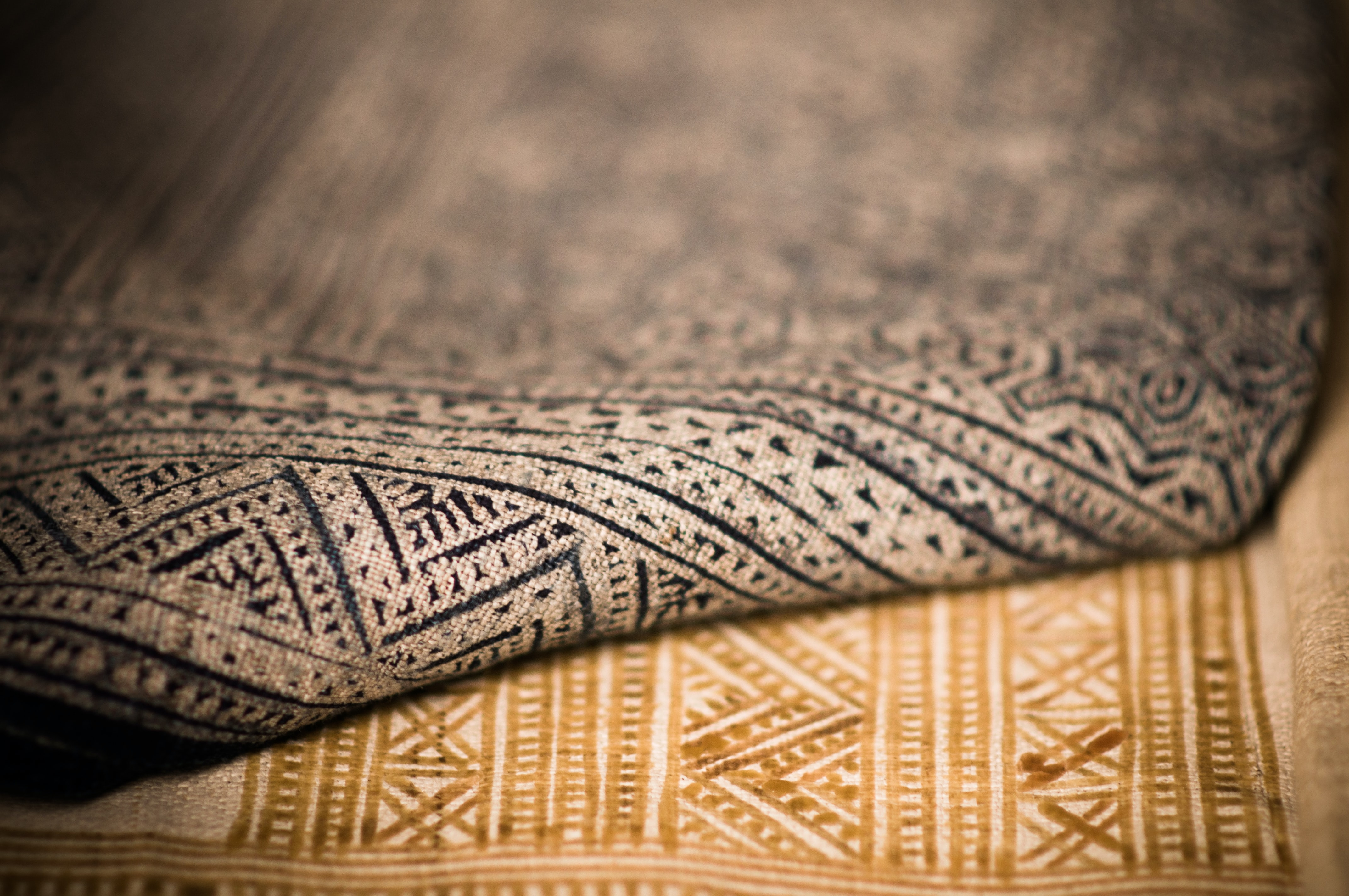 A close up that shows the texture of two different patterned rugs