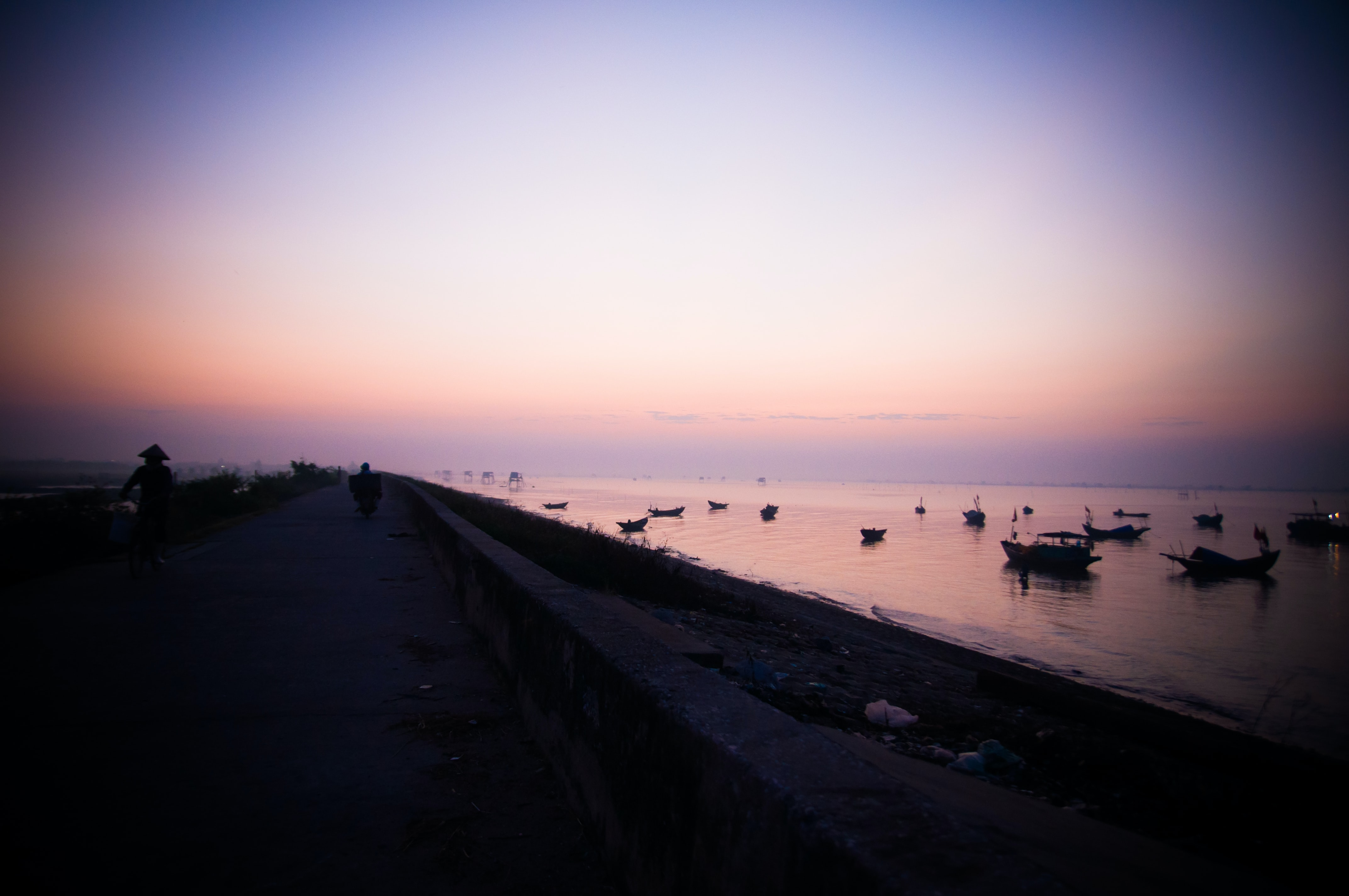 silhouette of boats on shore