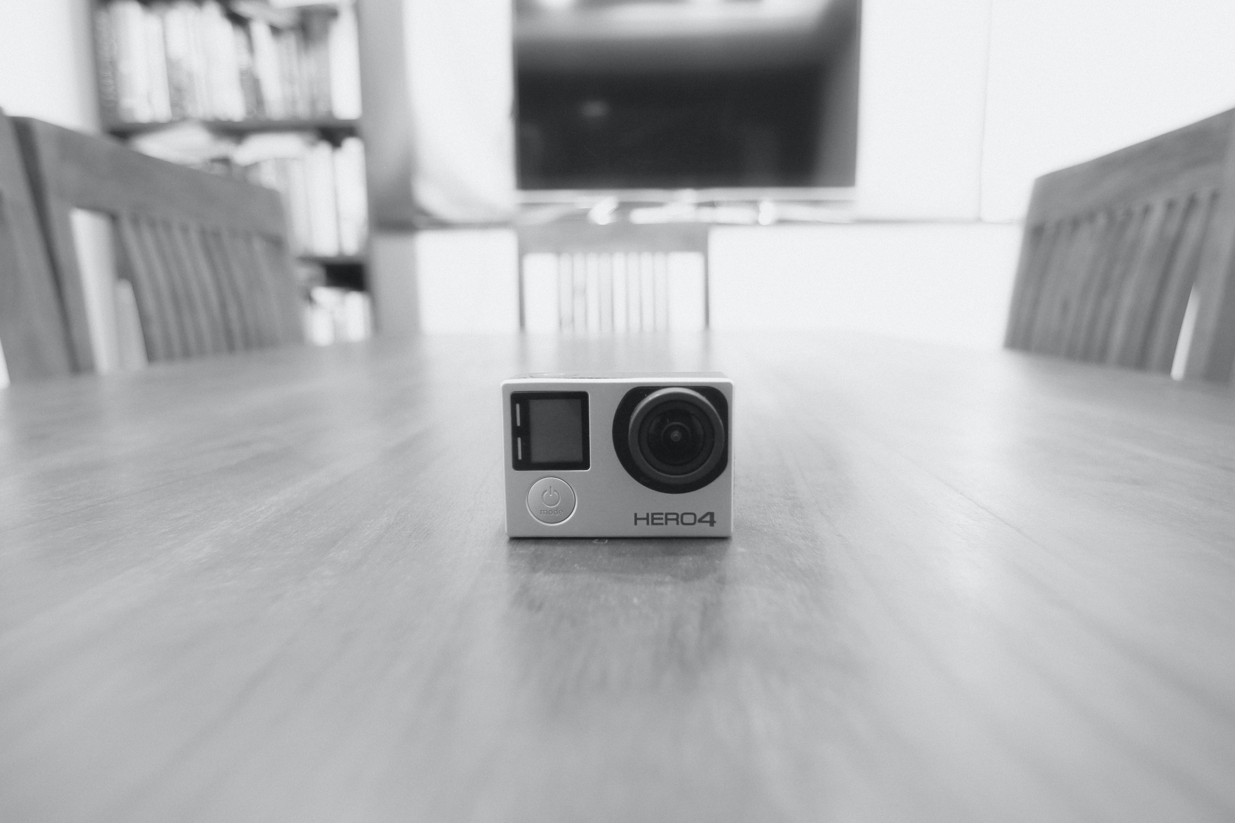 A GoPro Hero4 camera sitting on top of a kitchen table.