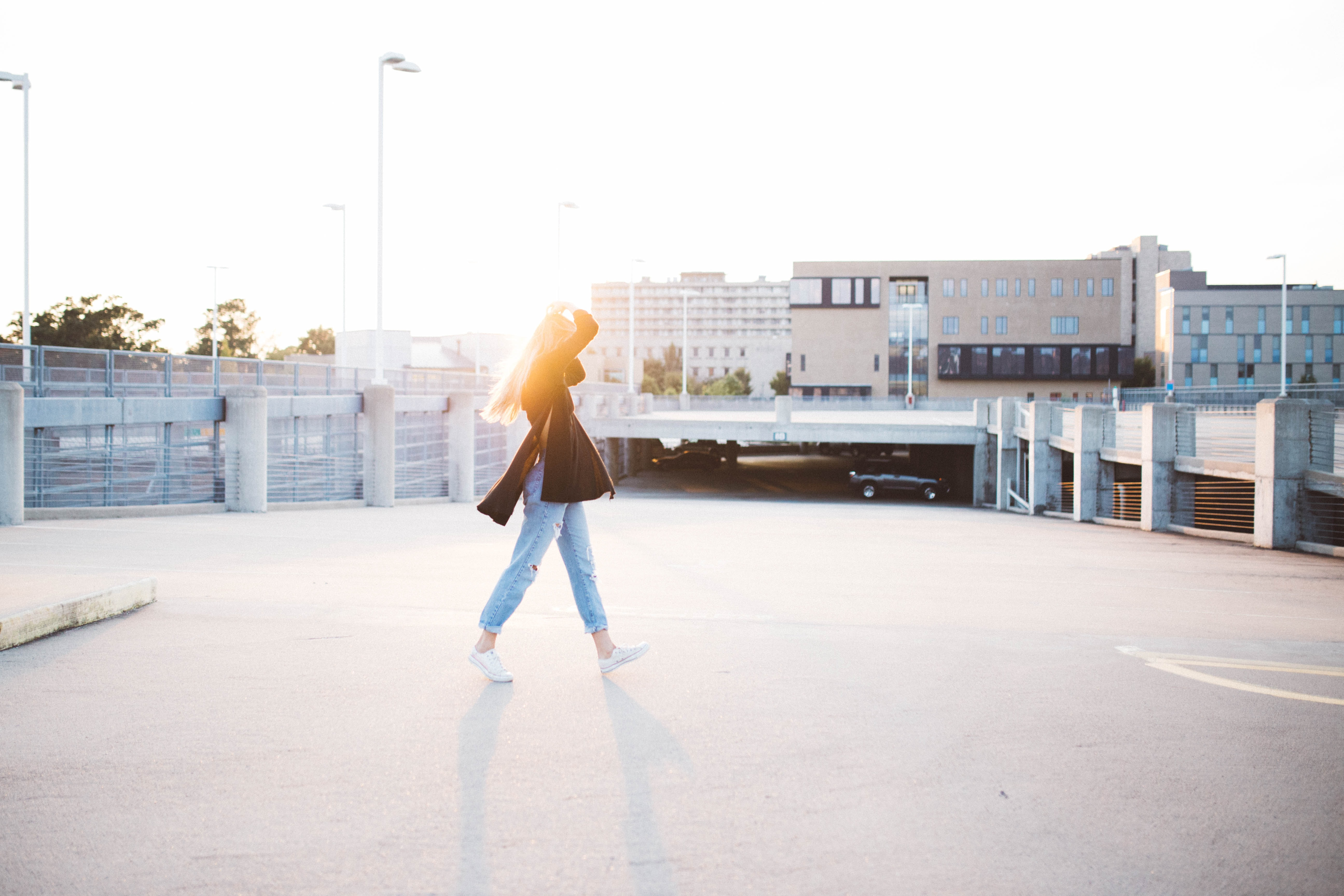 woman walking on road near building at daytime