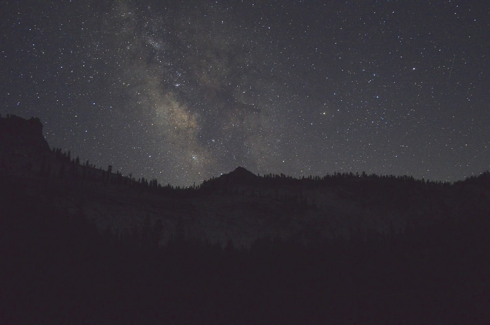 silhouette of a mountain during night