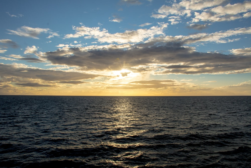 ocean under blue sky at golden houe