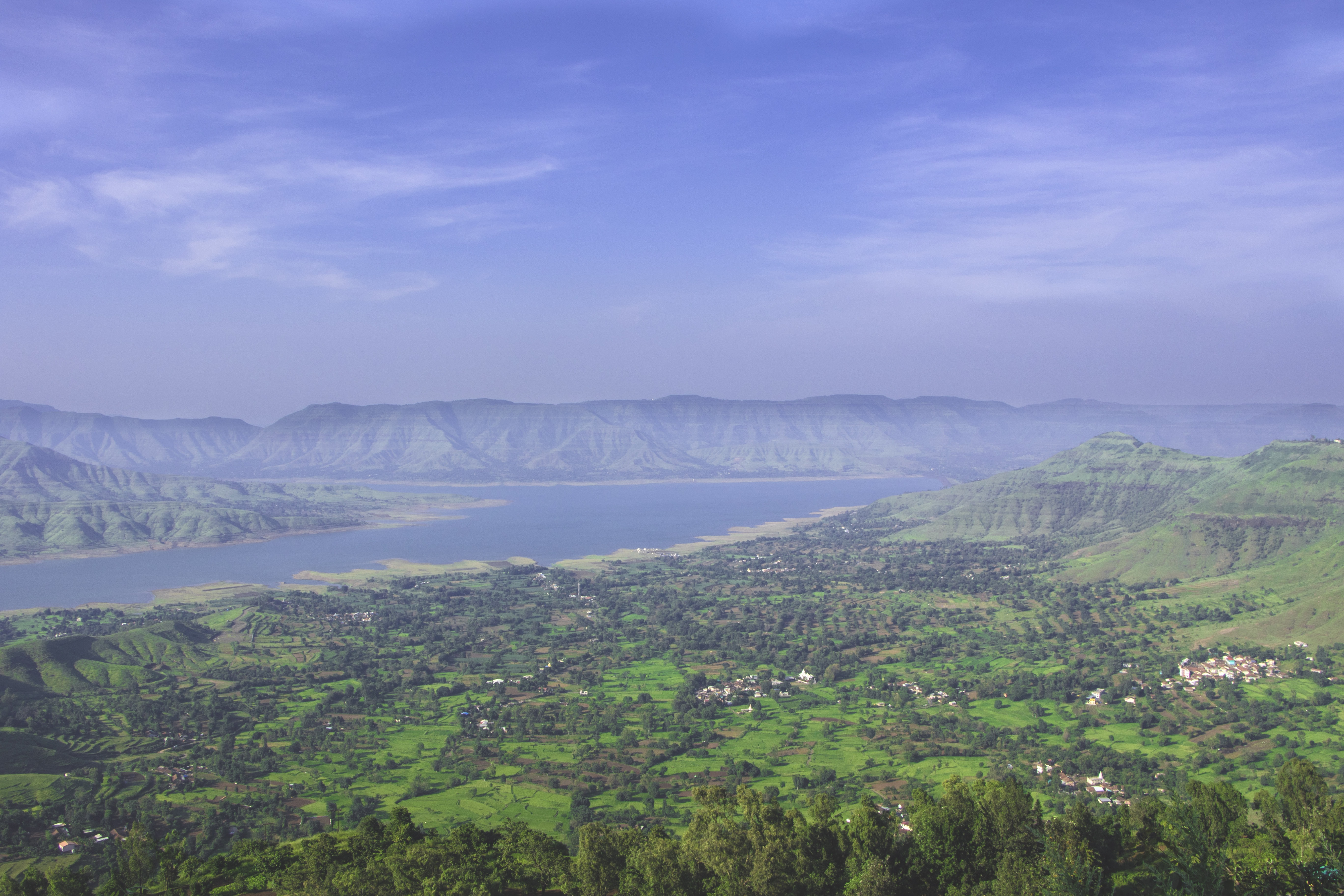 A vast rural landscape near a large river in Panchgani