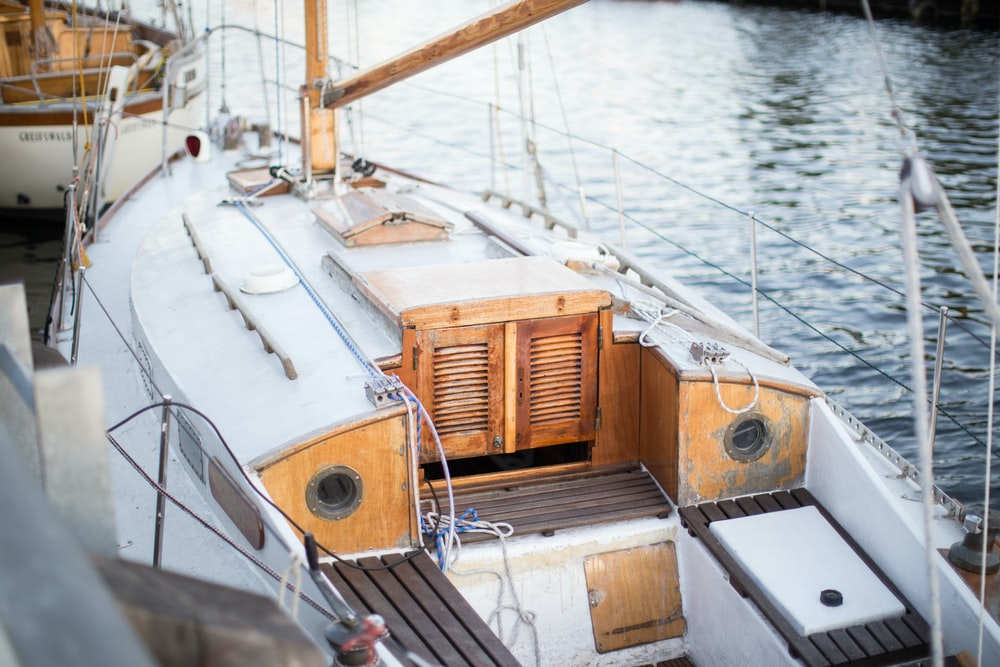 white and brown motorboat near dock