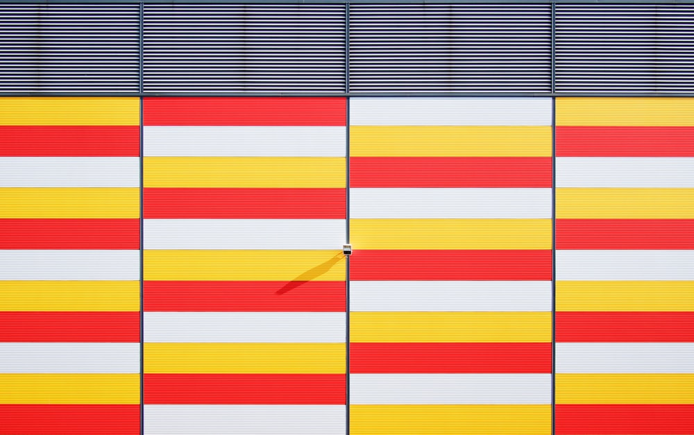 white, red, and yellow striped bars