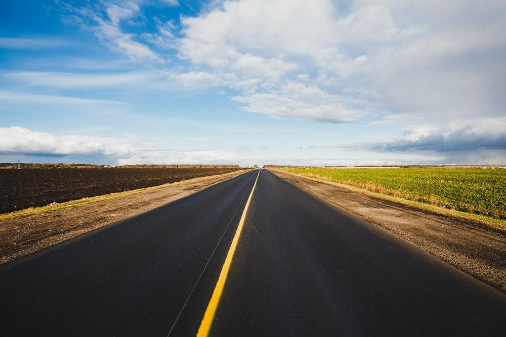 asphalt road under sky