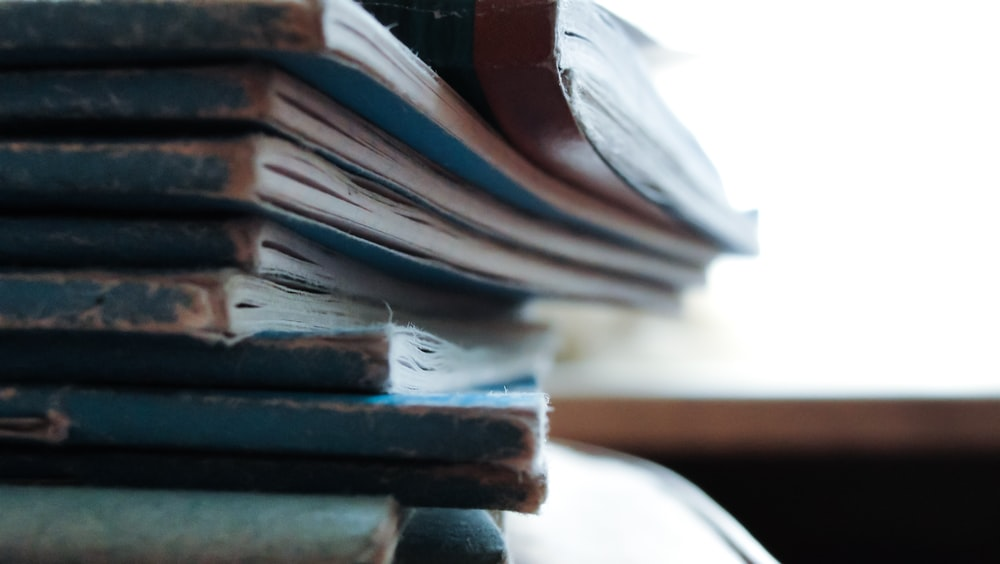 stacked blue notebooks