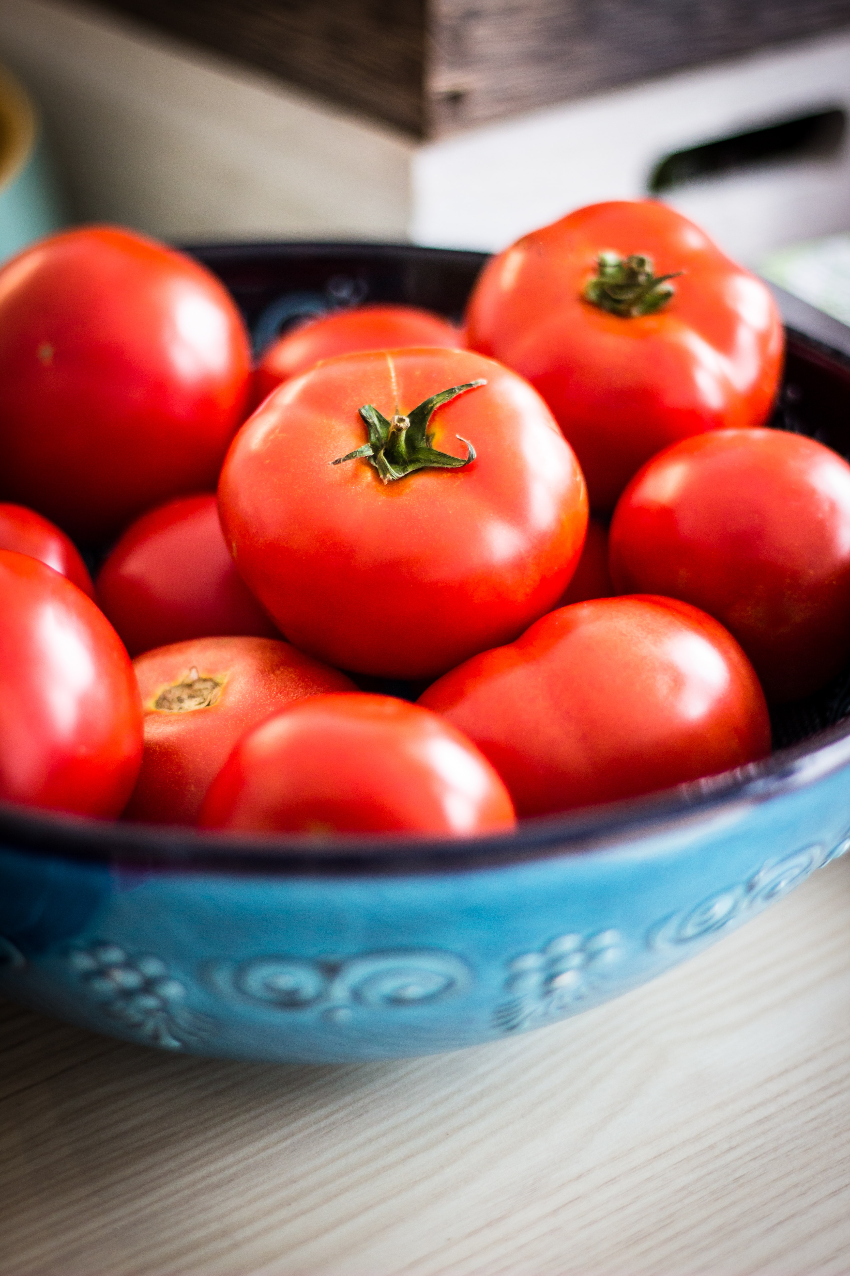 a bowl of red tomatoes