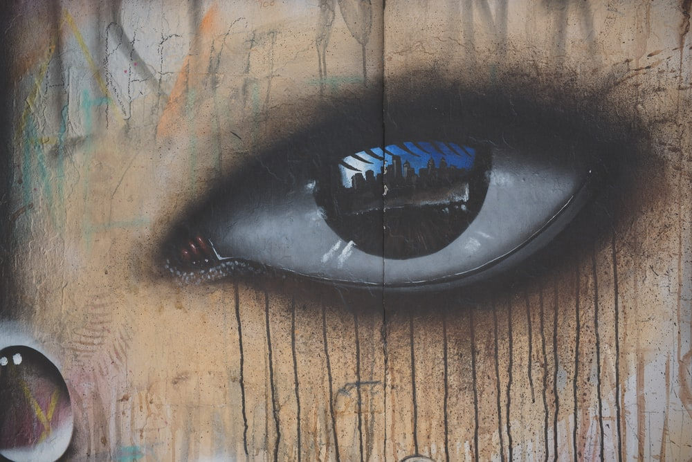 An eye painted on a wall.