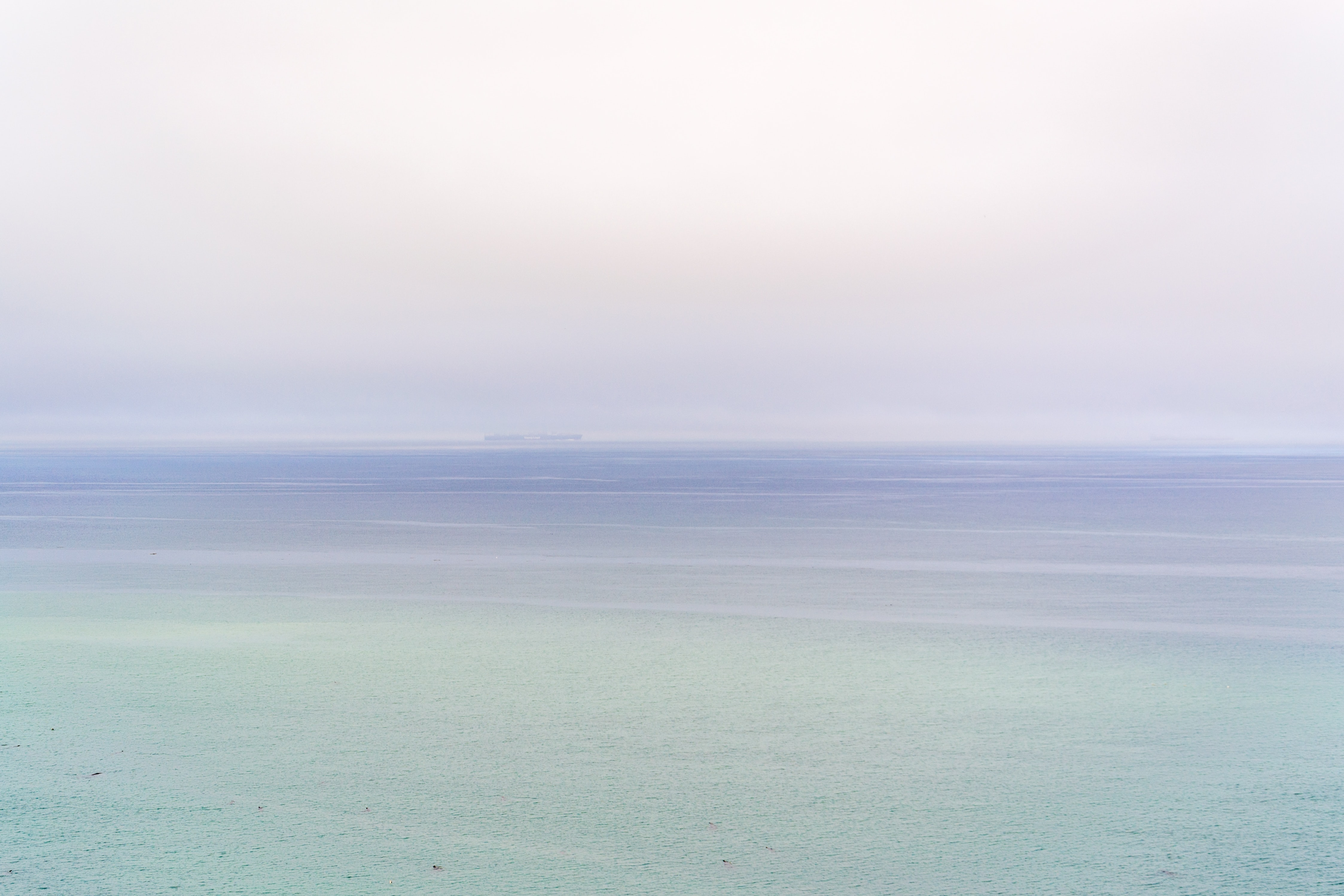 Tranquil color gradient of the sea, sky, and horizon