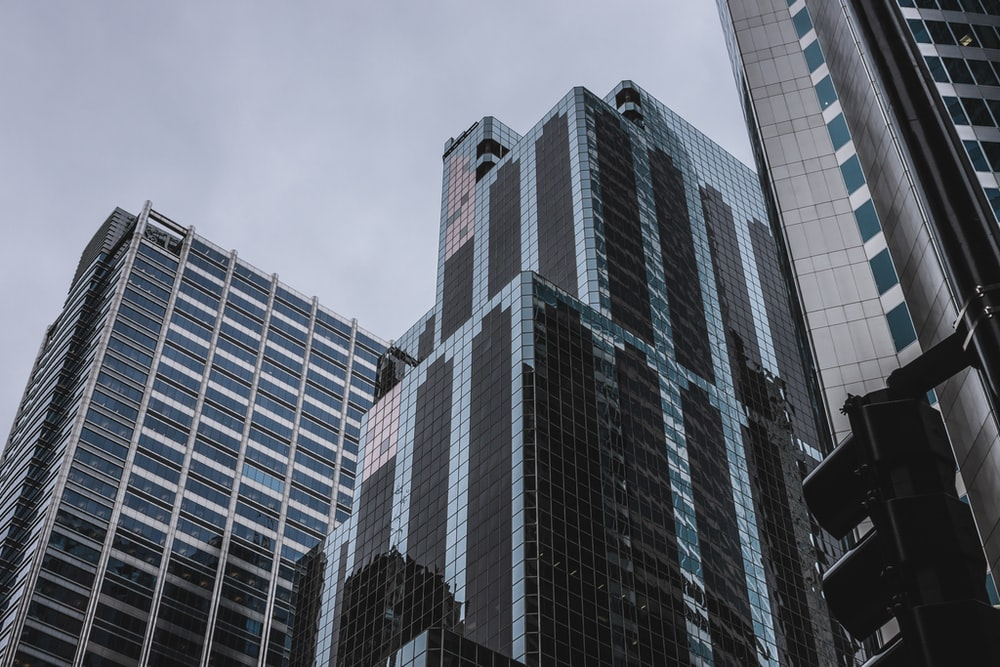 three tall buildings during daytime