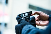 selective focus photography of person taking picture of the road