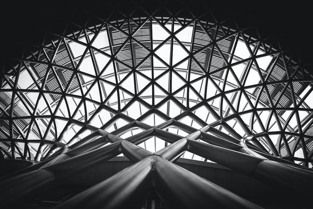 grayscale photo of scaffolding